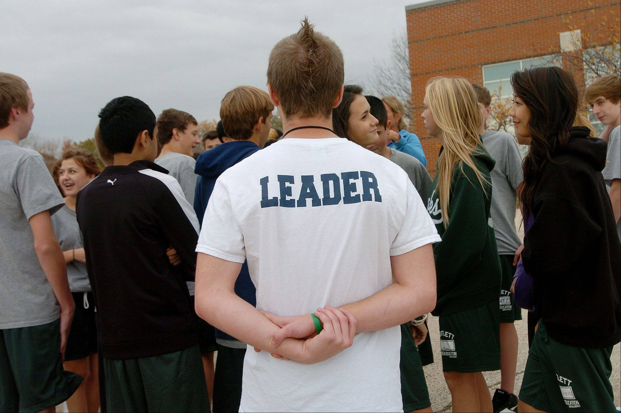 Senior team leader Nick LoBosco watches a team-building exercise during a Bartlett High School senior leaders program.