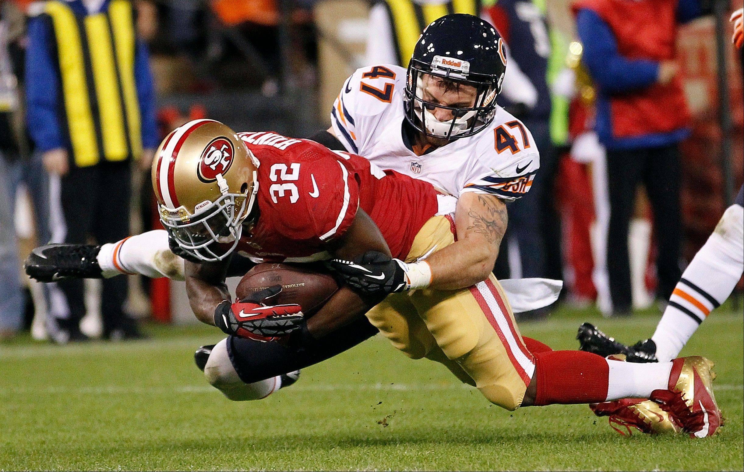 San Francisco 49ers running back Kendall Hunter scores on a 14-yard touchdown run past Chicago Bears free safety Chris Conte during the second quarter.