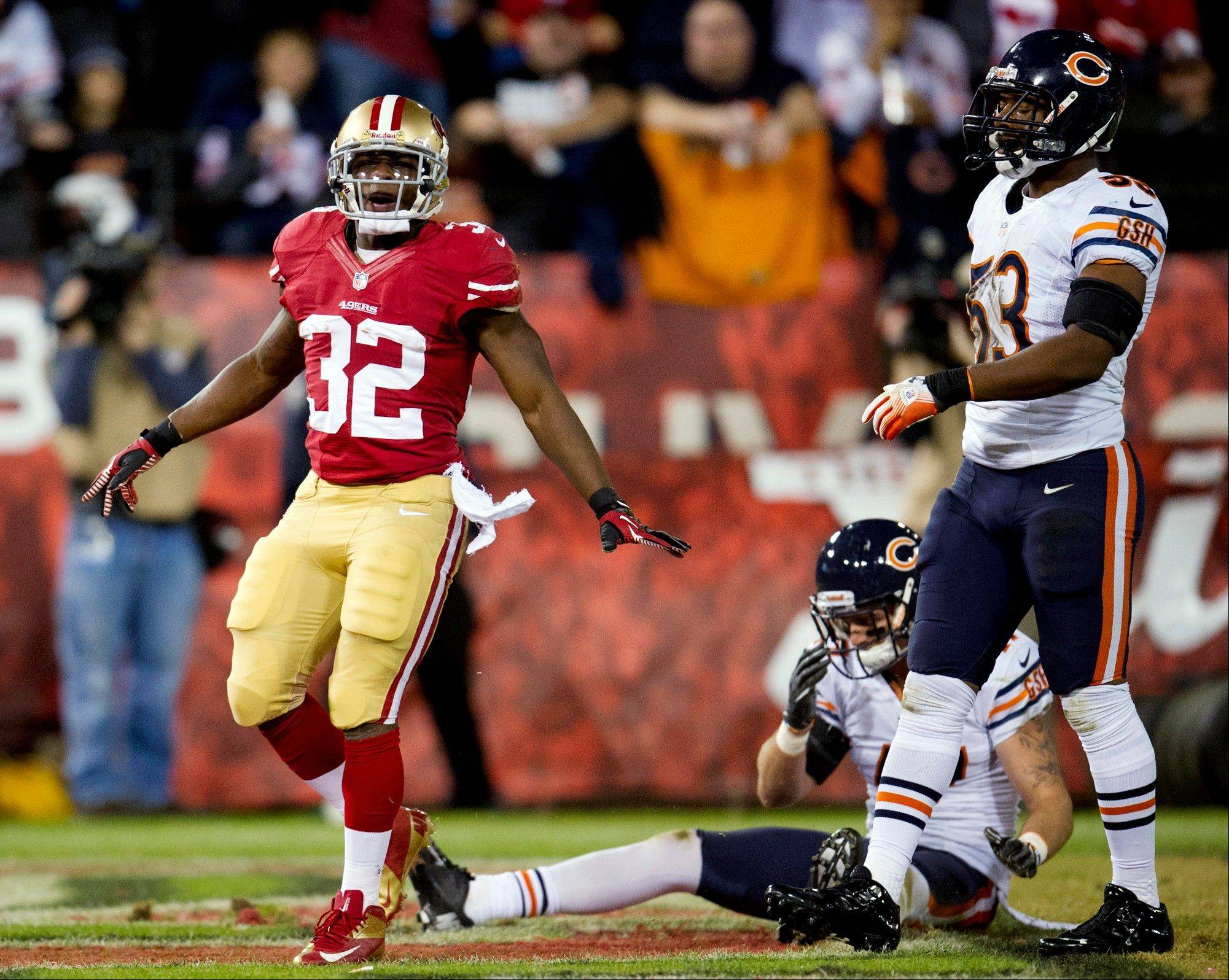 San Francisco 49ers running back Kendall Hunter celebrates his touchdown against the Chicago Bears during the second quarter.
