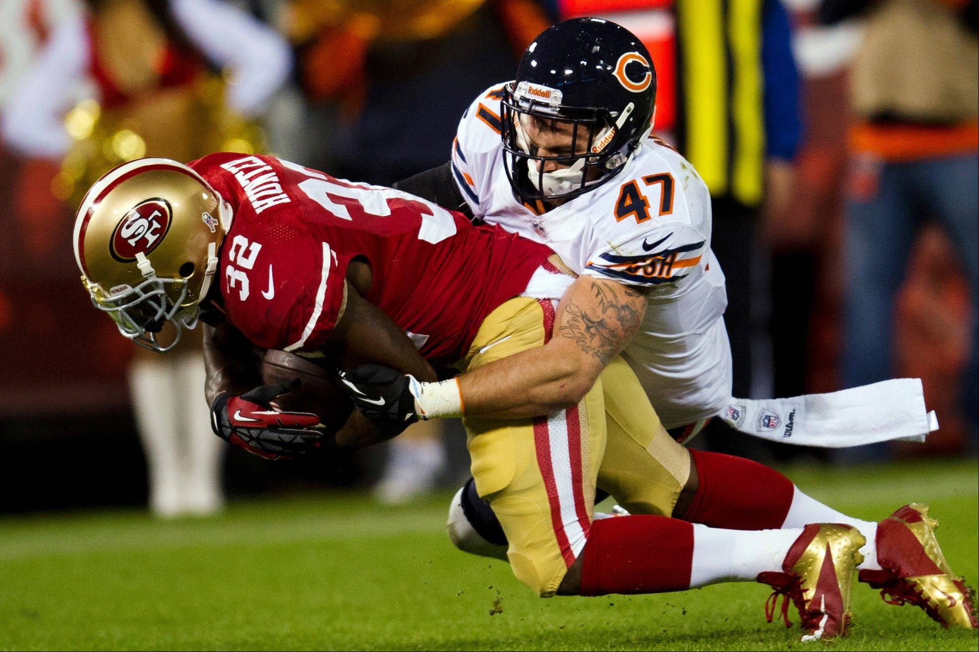 San Francisco 49ers running back Kendall Hunter is tackled by Chicago Bears free safety Chris Conte as he leans into the end zone for a touchdown during the second quarter.