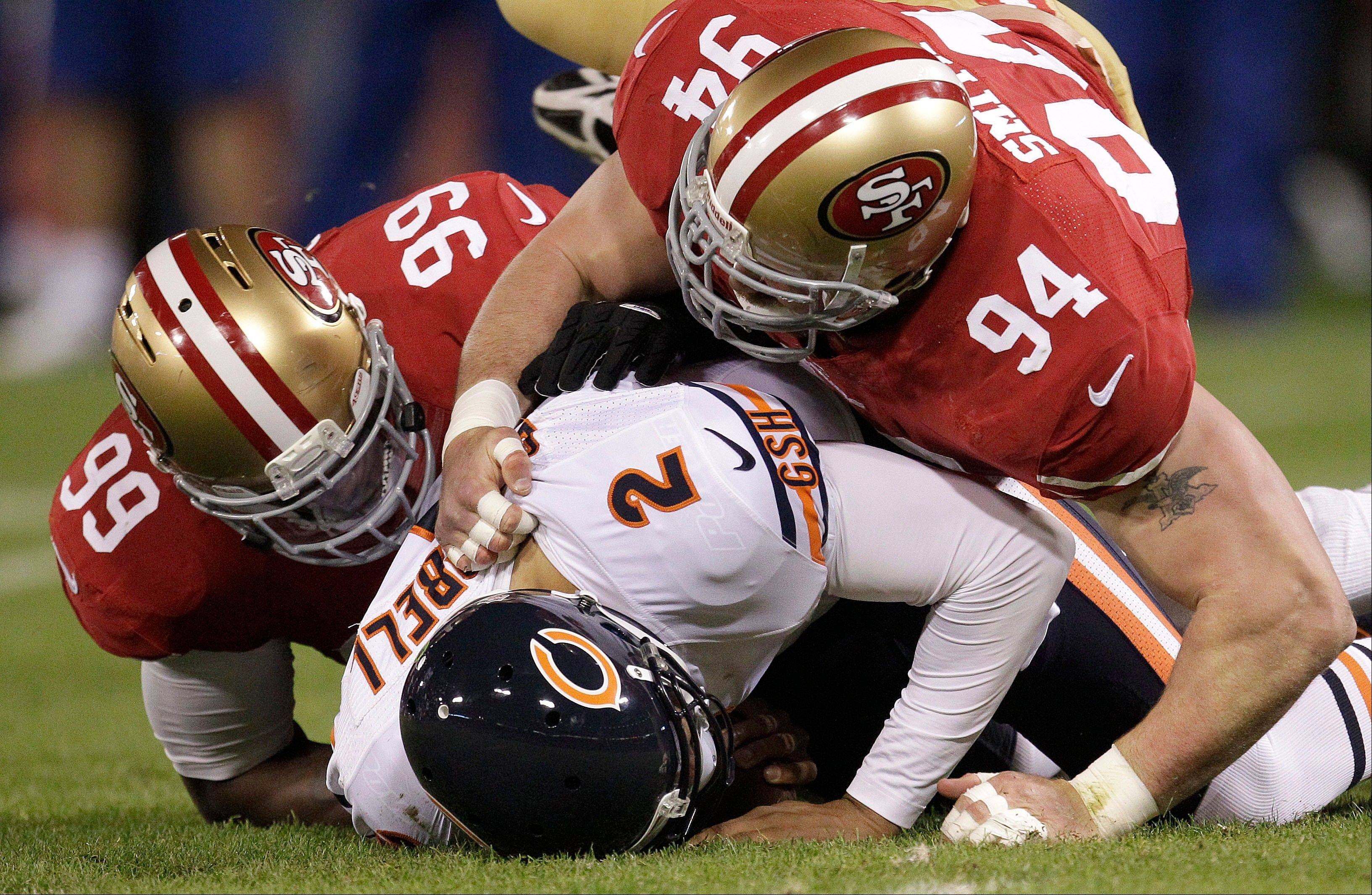 Chicago Bears quarterback Jason Campbell is sacked by San Francisco 49ers linebacker Aldon Smith as defensive tackle Justin Smith follows the play during the first quarter.