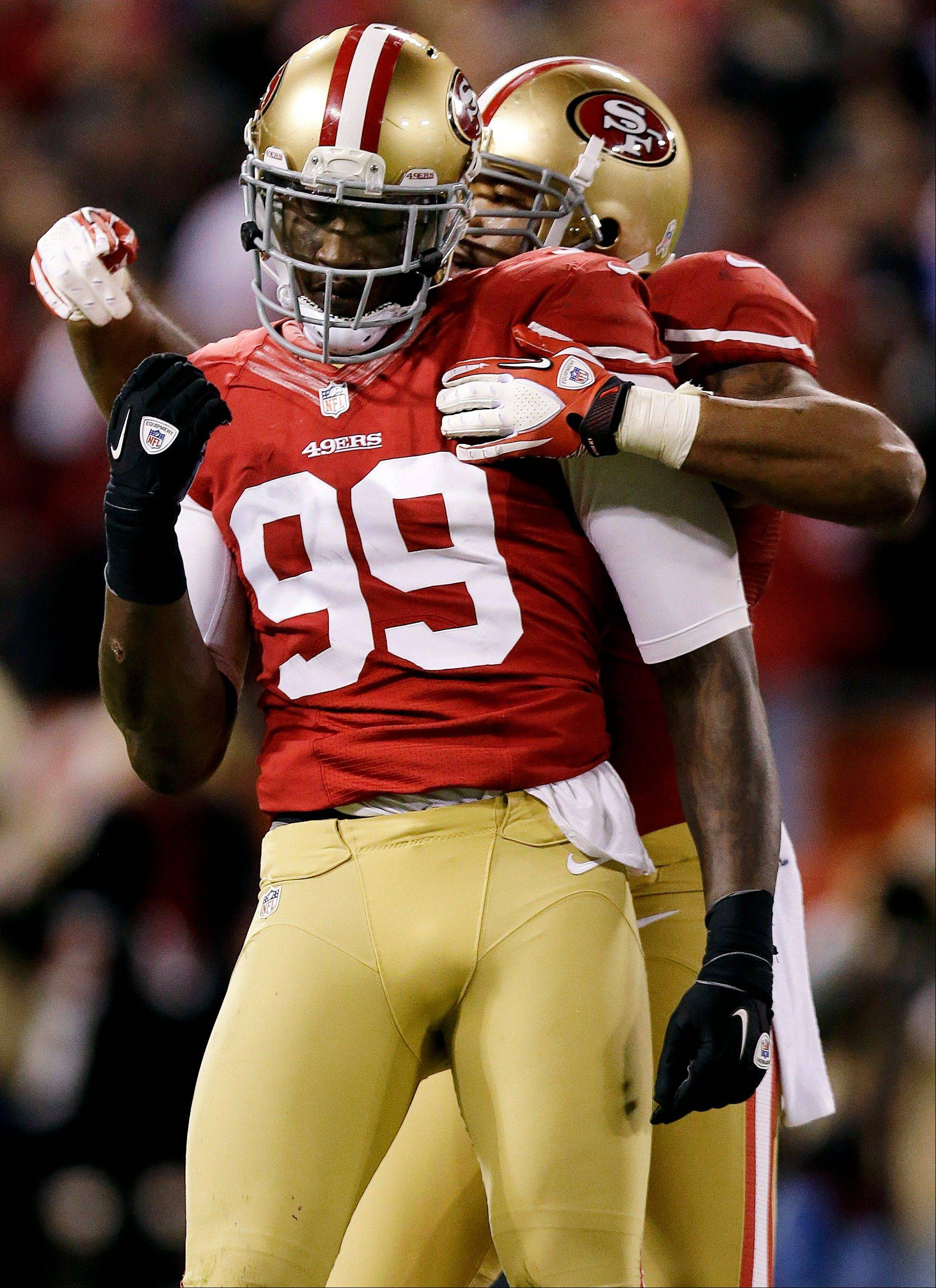 San Francisco 49ers linebacker Aldon Smith is congratulated by linebacker Ahmad Brooks after sacking Chicago Bears quarterback Jason Campbell during the third quarter.