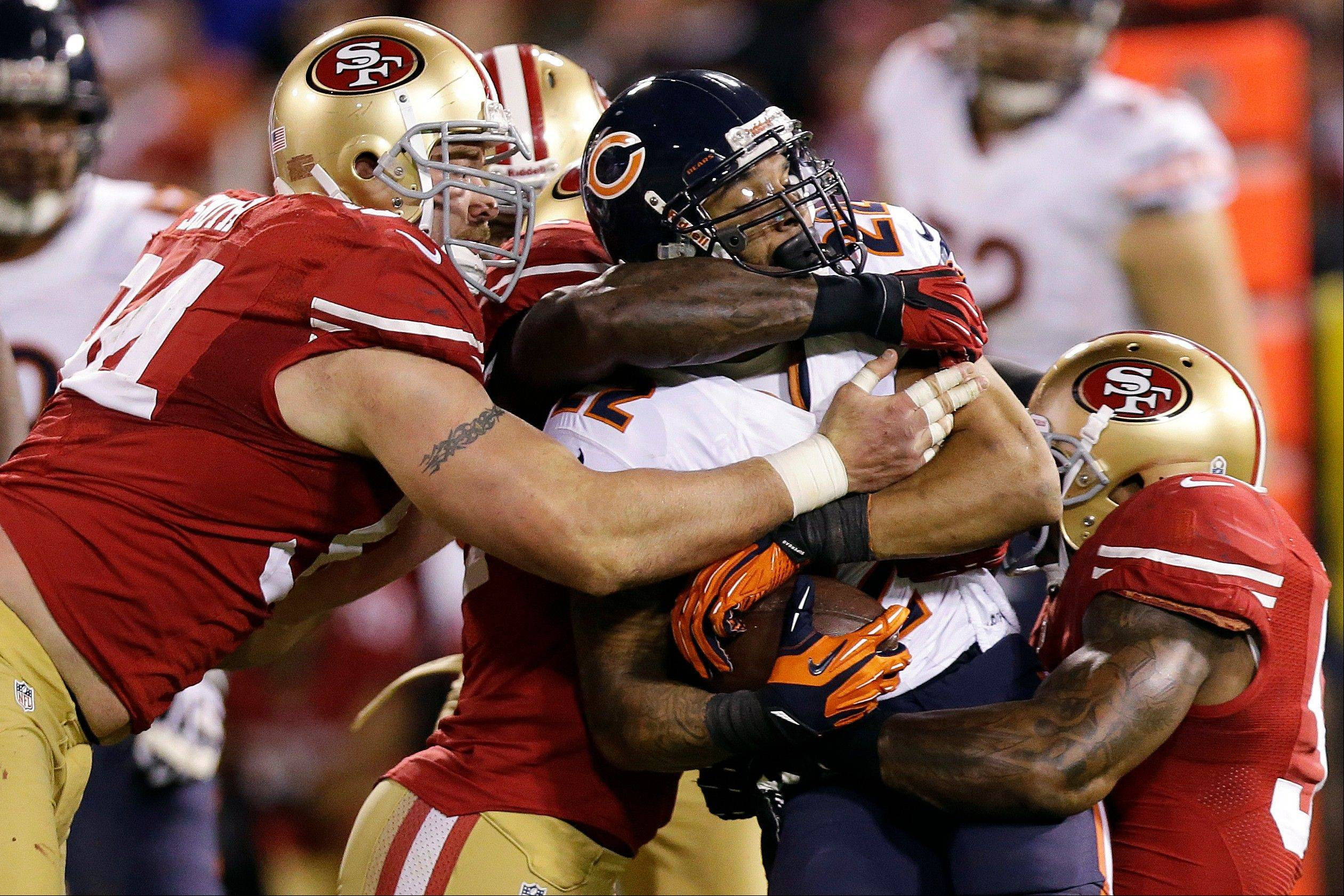 Chicago Bears running back Matt Forte is tackled by San Francisco 49ers defensive tackle Justin Smith, linebacker Patrick Willis, rear, and linebacker NaVorro Bowman during the third quarter.