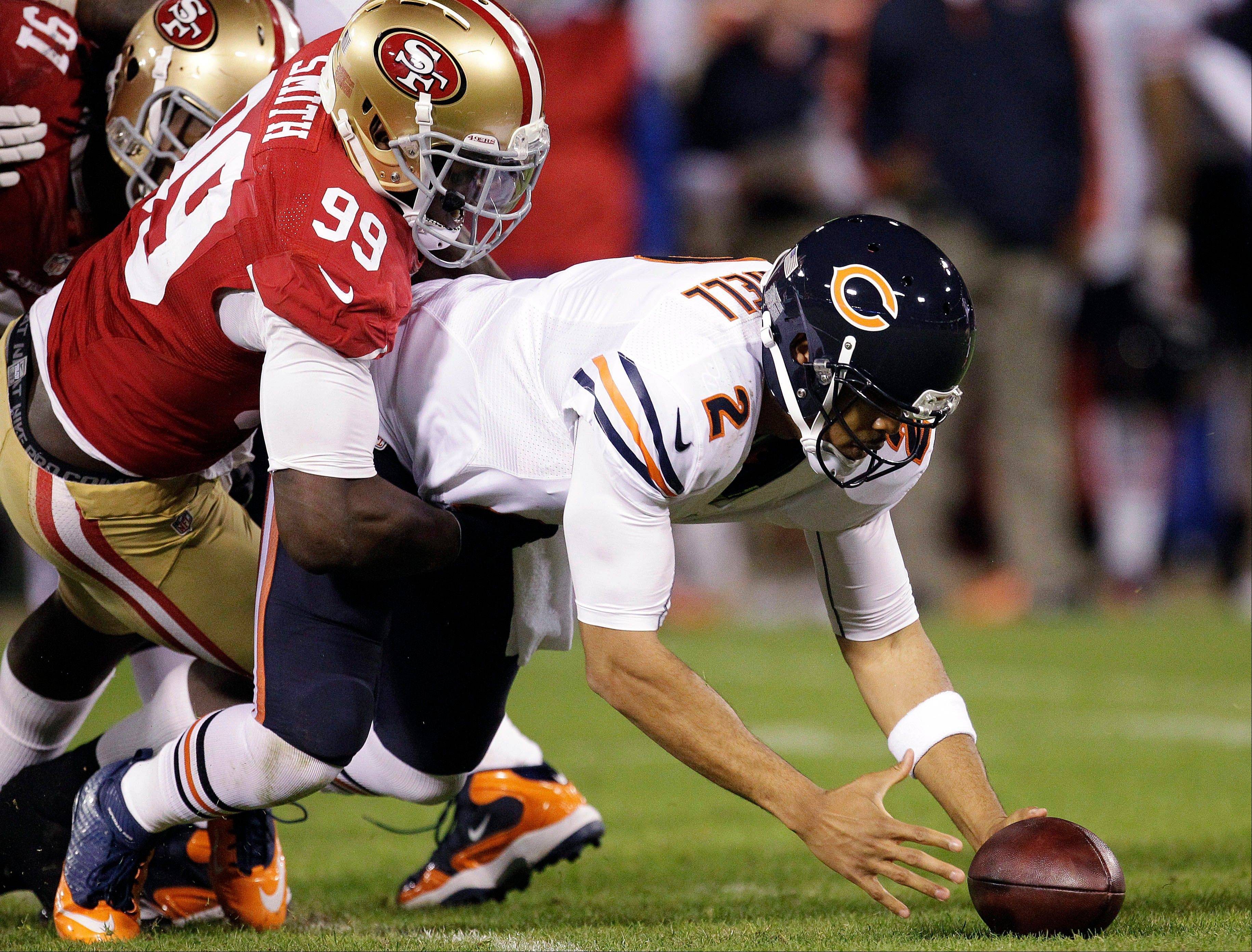 Chicago Bears quarterback Jason Campbell recovers his own fumble after being sacked by San Francisco 49ers linebacker Aldon Smith during the second quarter.