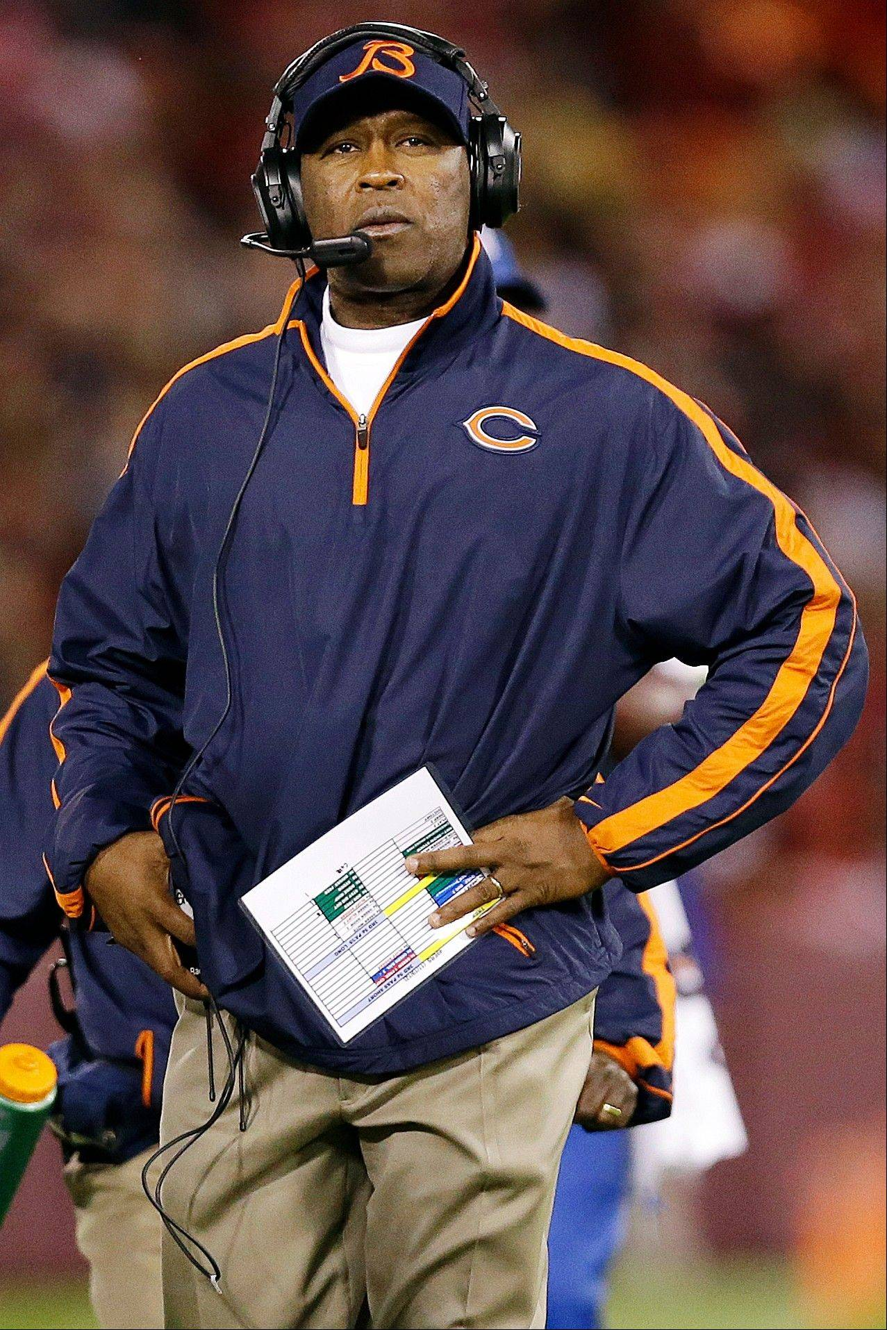 Chicago Bears head coach Lovie Smith stands on the sideline during the third quarter.