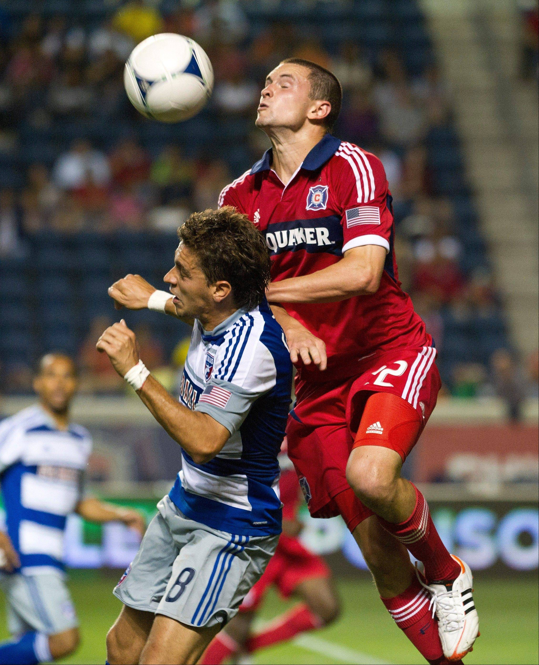 Chicago Fire defender Austin Berry, right, has earned Rookie of the Year honors in the MLS for the 2012 season.