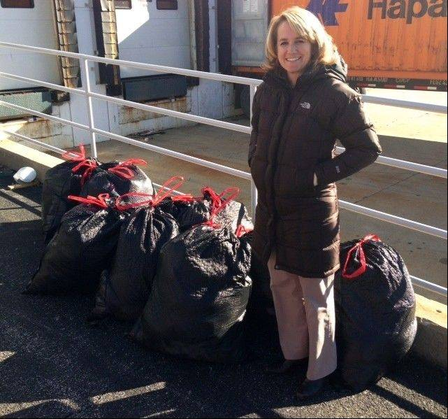 Susan Rogers, Northwest Suburban Council PTA health and safety chairman, with the council's donation for the Hurricane Sandy relief drive led by RIM Logistics.