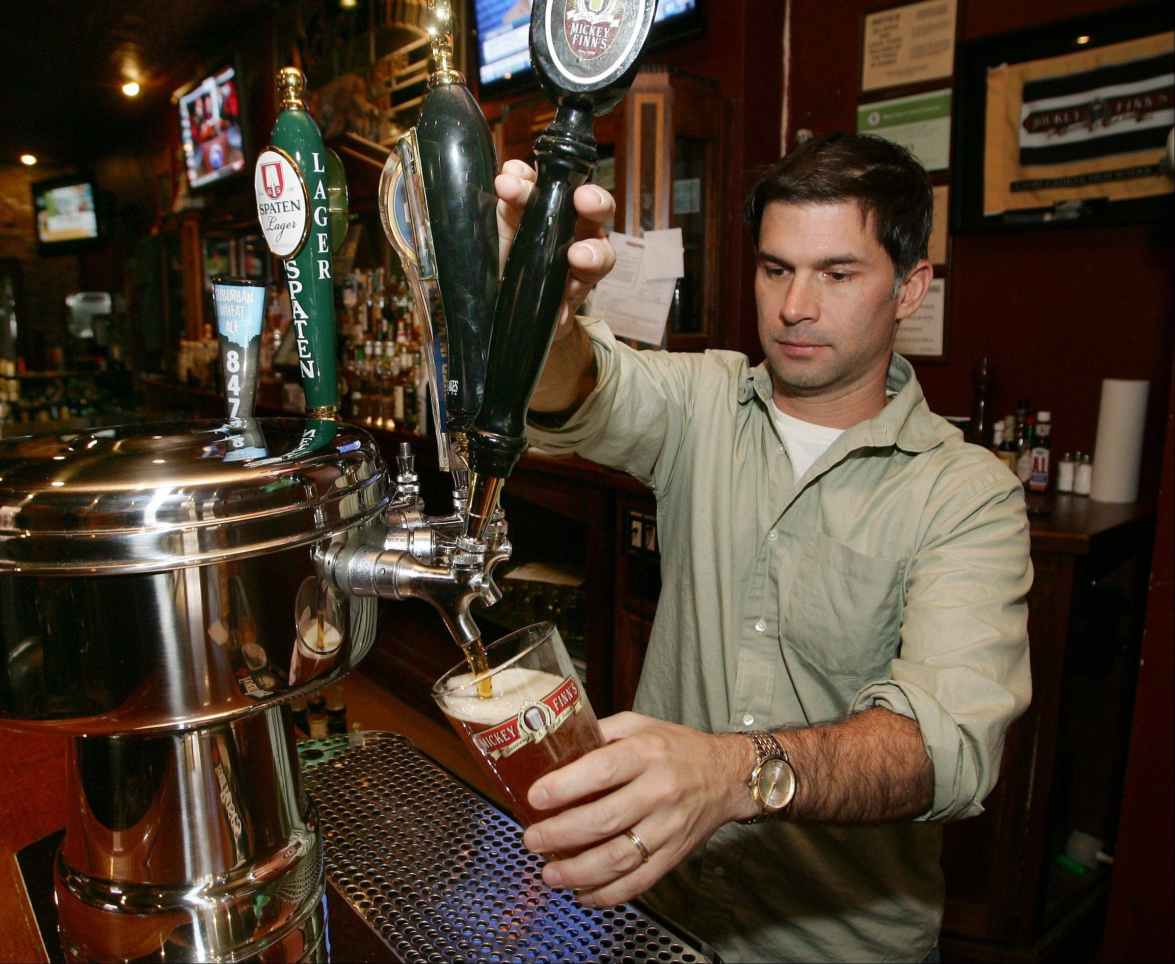 The beer will flow Wednesday at Mickey Finn's in Libertyville. Brew pub owner Brian Grano says Thanksgiving Eve is one of the biggest bar nights of the year.