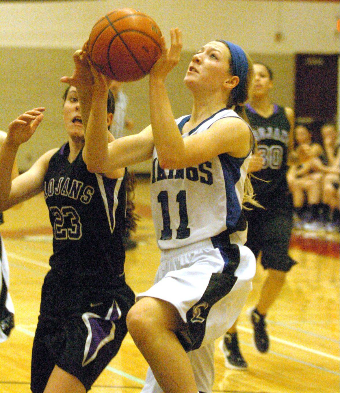 Geneva�s Michaela Loebel goes in for a layup.