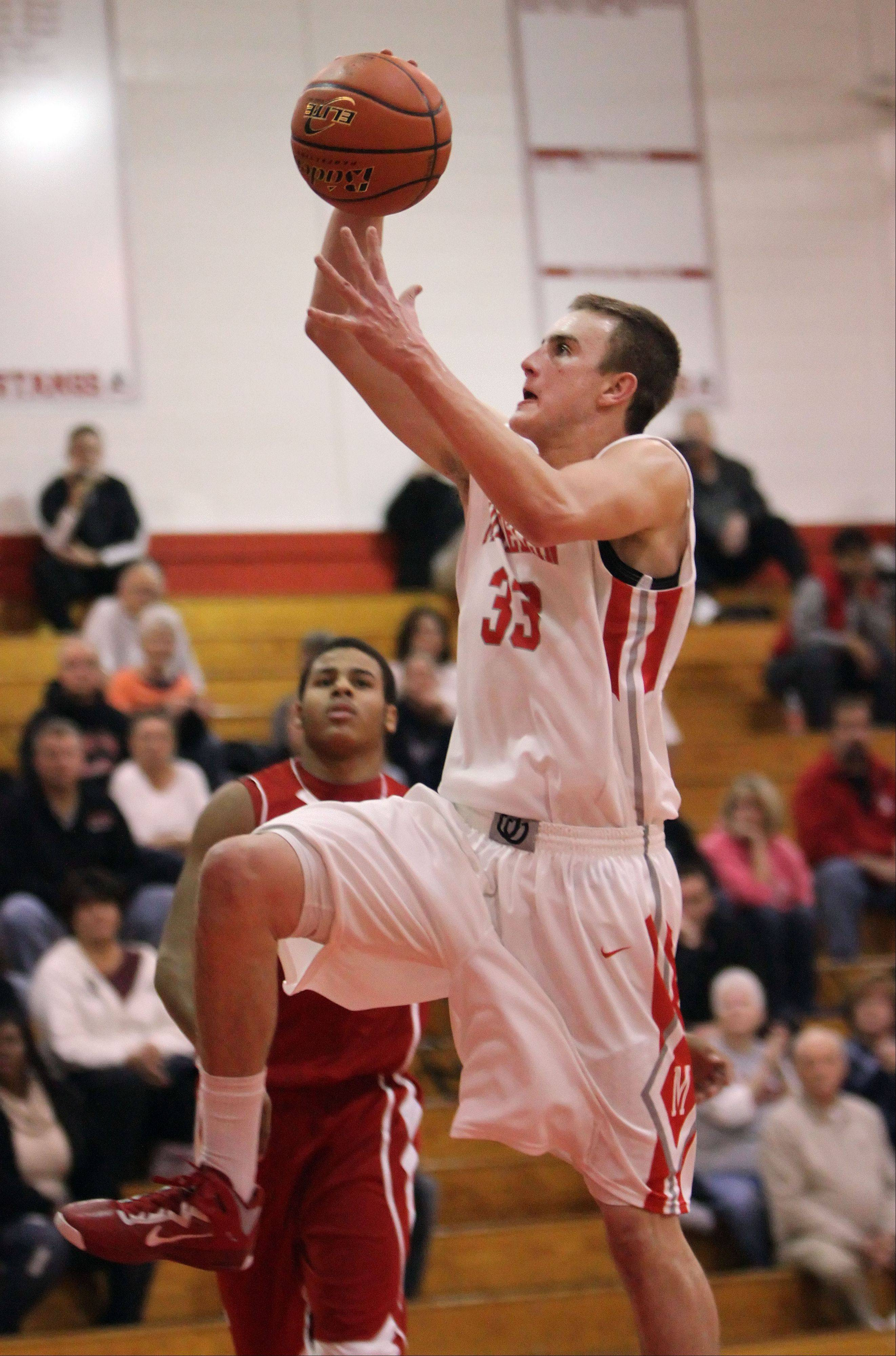 Mundelein�s Sean O�Brien drives in for a dunk during their game against Lakes Tuesday night at Mundelein.