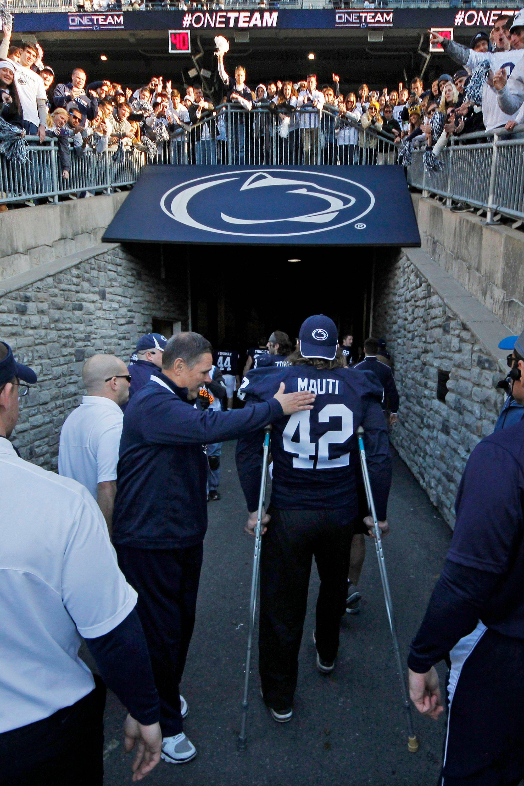 Penn State linebacker Michael Mauti walks to the locker room on crutches after their 45-22 win over Indiana in State College, Pa. Mauti was injured on a play in the first quarter of the game and did not return to the game.