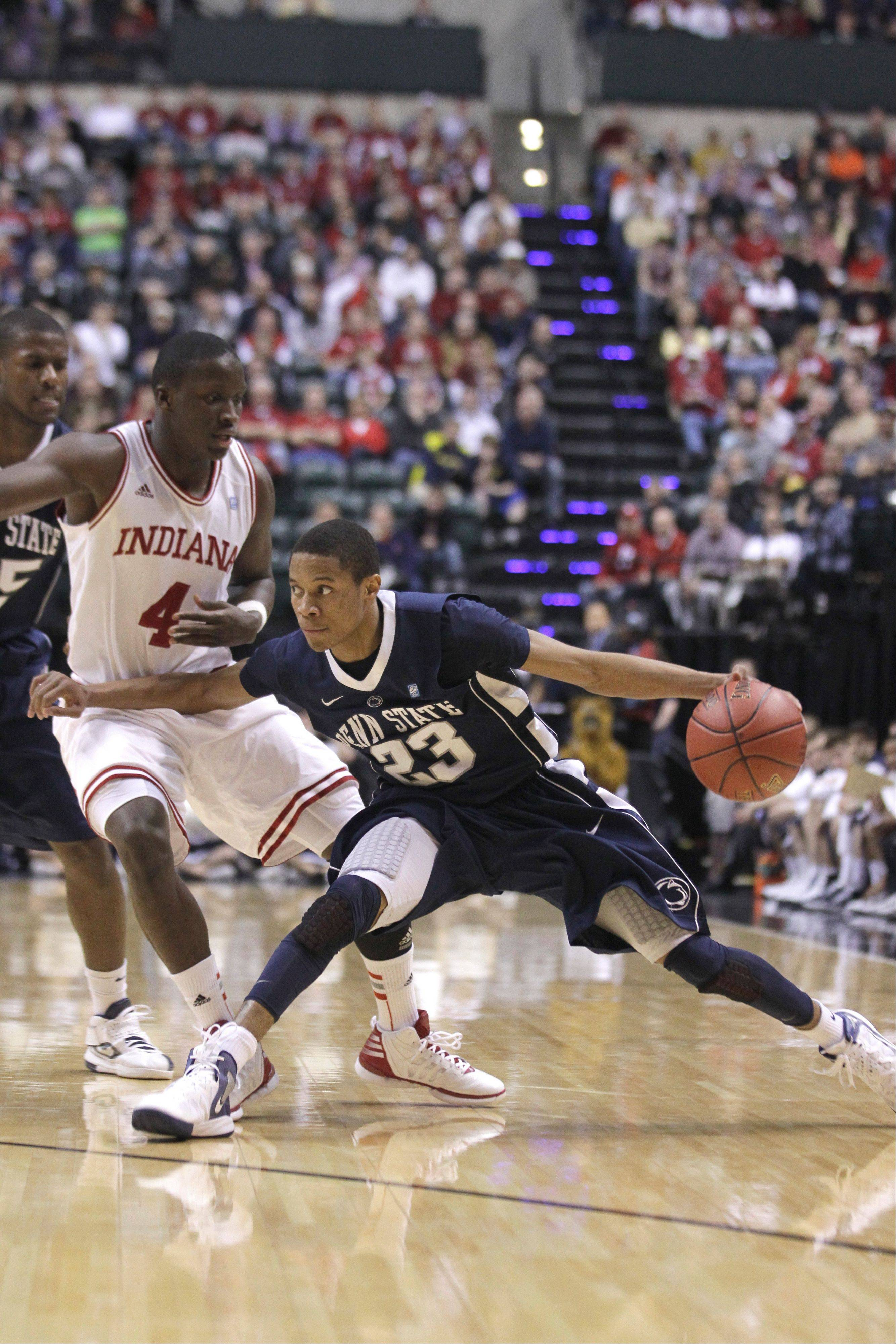 Penn State guard Tim Frazier, here driving against Indiana in last season's Big Ten Conference tournament, will miss the rest of the season with a ruptured left Achilles tendon.