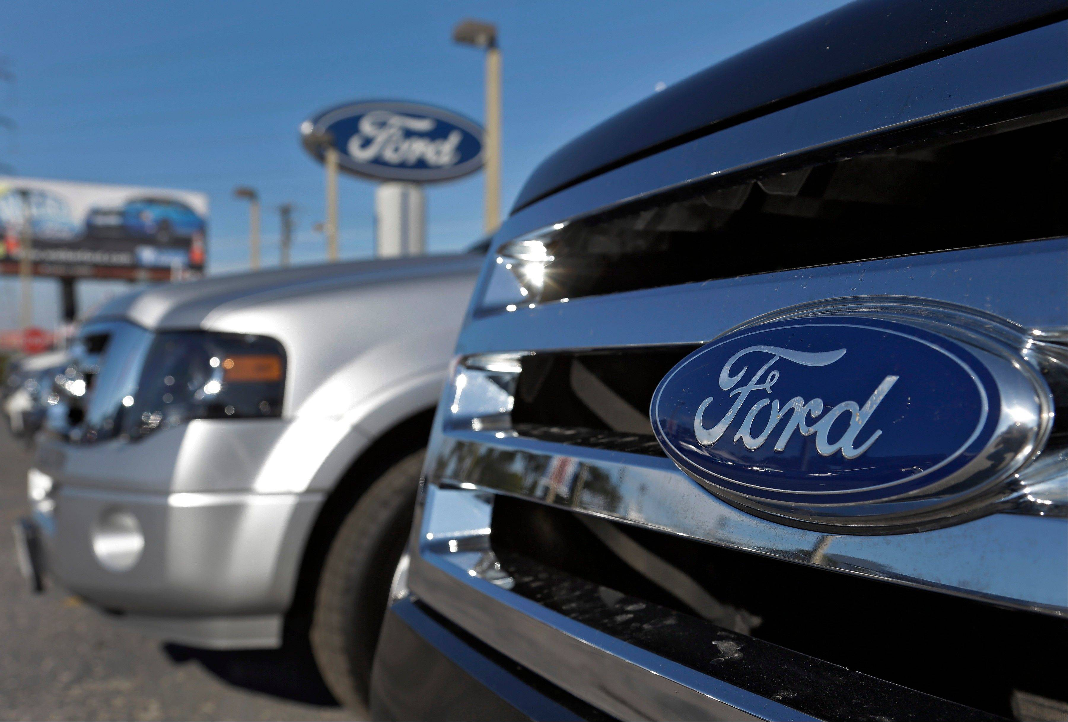 GE said Tuesday it is buying 2,000 plug-in hybrid cars from Ford for its corporate fleet.