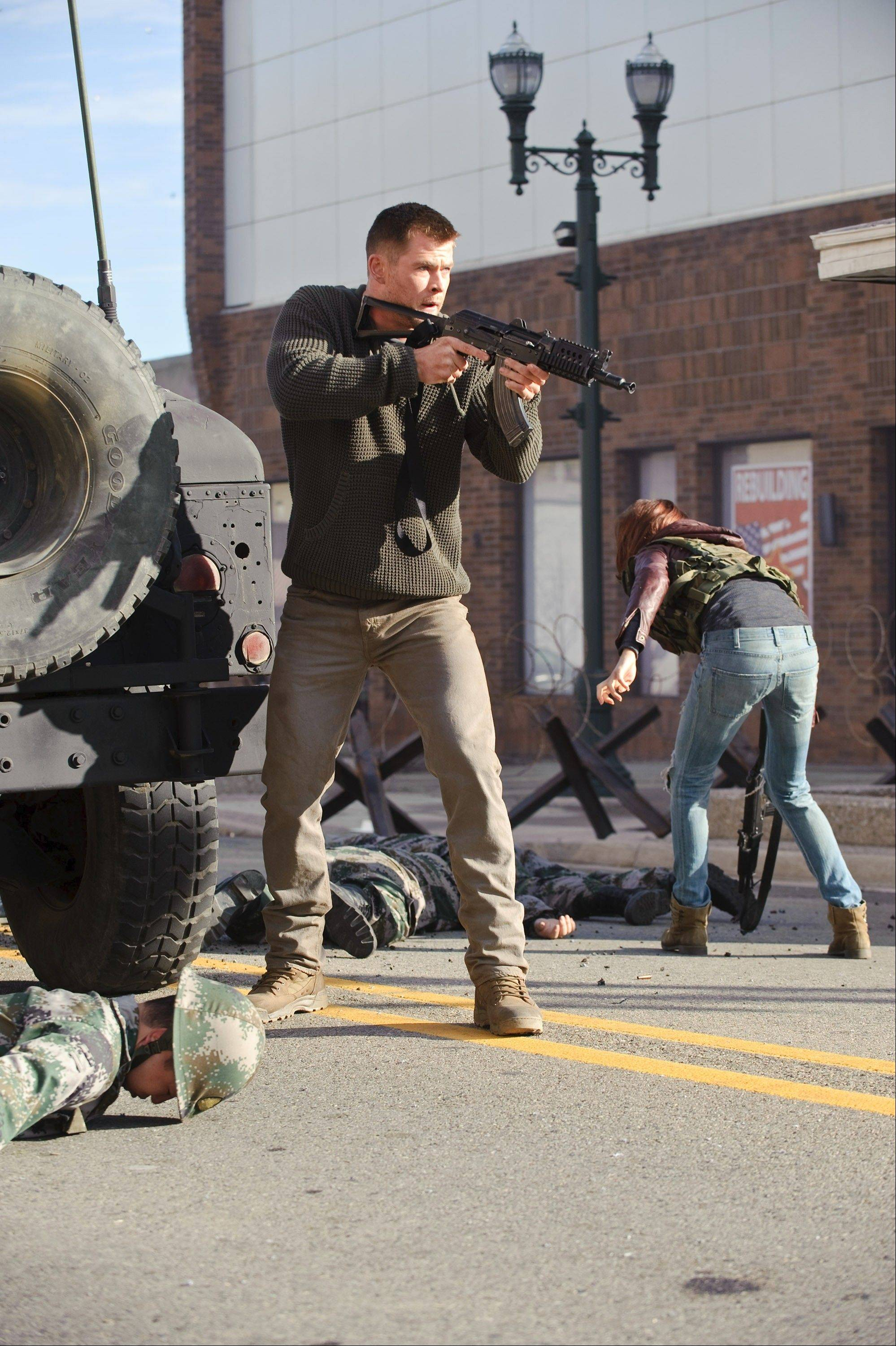 "Jed (Chris Hemsworth) takes aim at nasty North Korean invaders in the action -- packed remake of the Cold War thriller ""Red Dawn."""