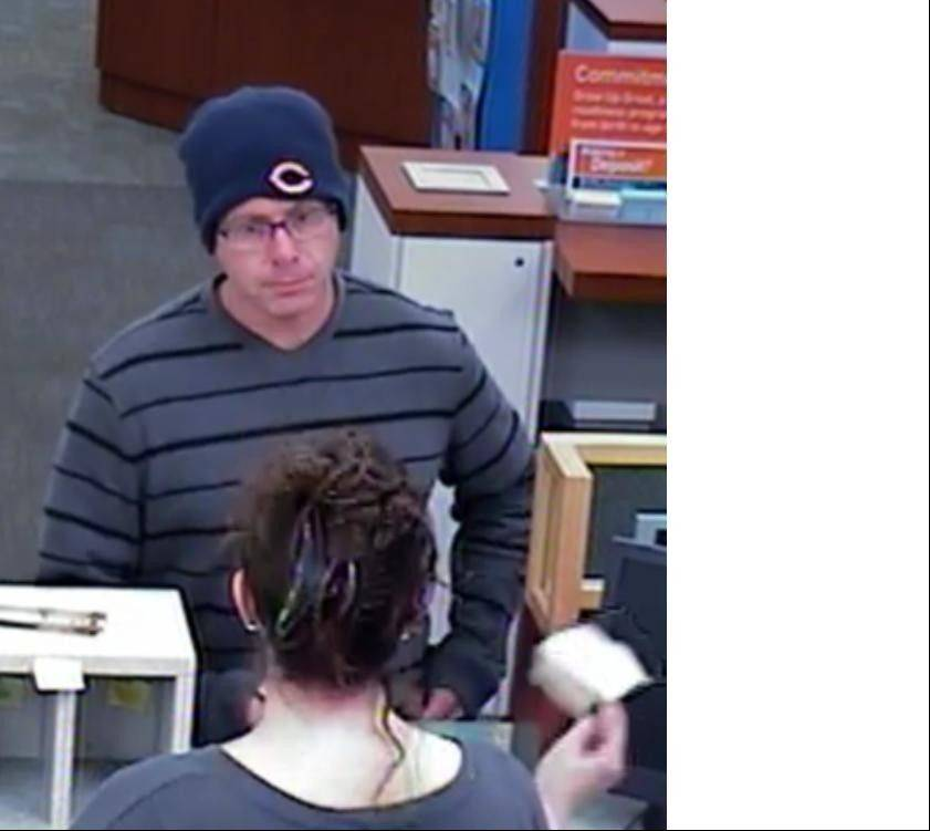 This surveillance photo shows a man who police say robbed a Buffalo Grove Bank Monday afternoon.