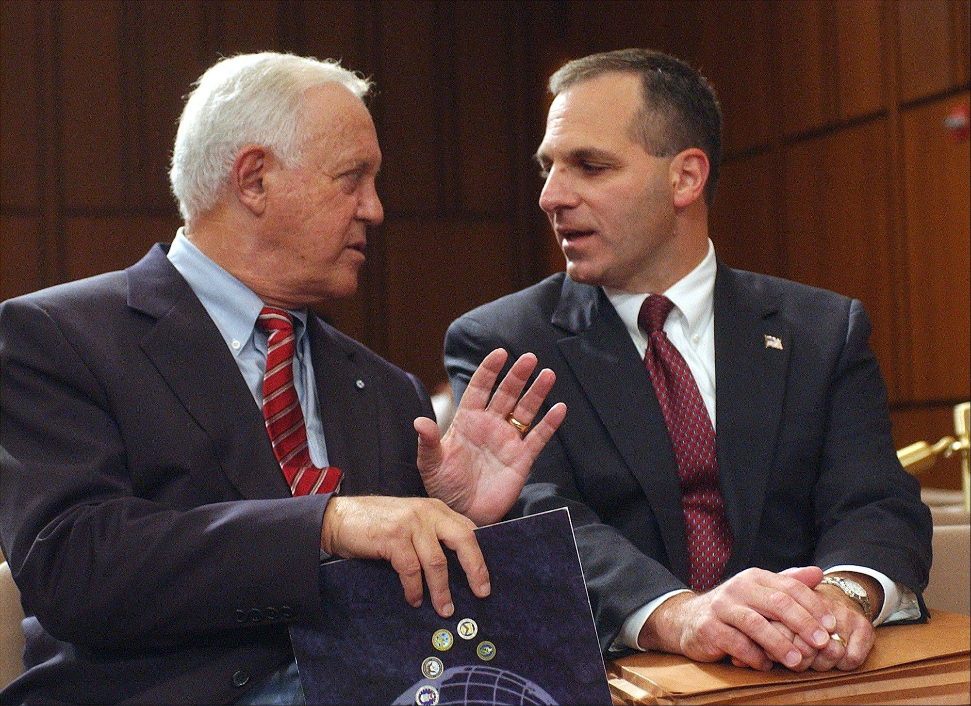 Former New Hampshire Sen. Warren Rudman, left, talks with former FBI Director Louis Freeh on Capitol Hill in Washington in this file photo from 2002. Rudman, who co-authored a ground-breaking budget balancing law, championed ethics and led a commission that predicted the danger of homeland terrorist attacks before 9/11, has died. He was 82.