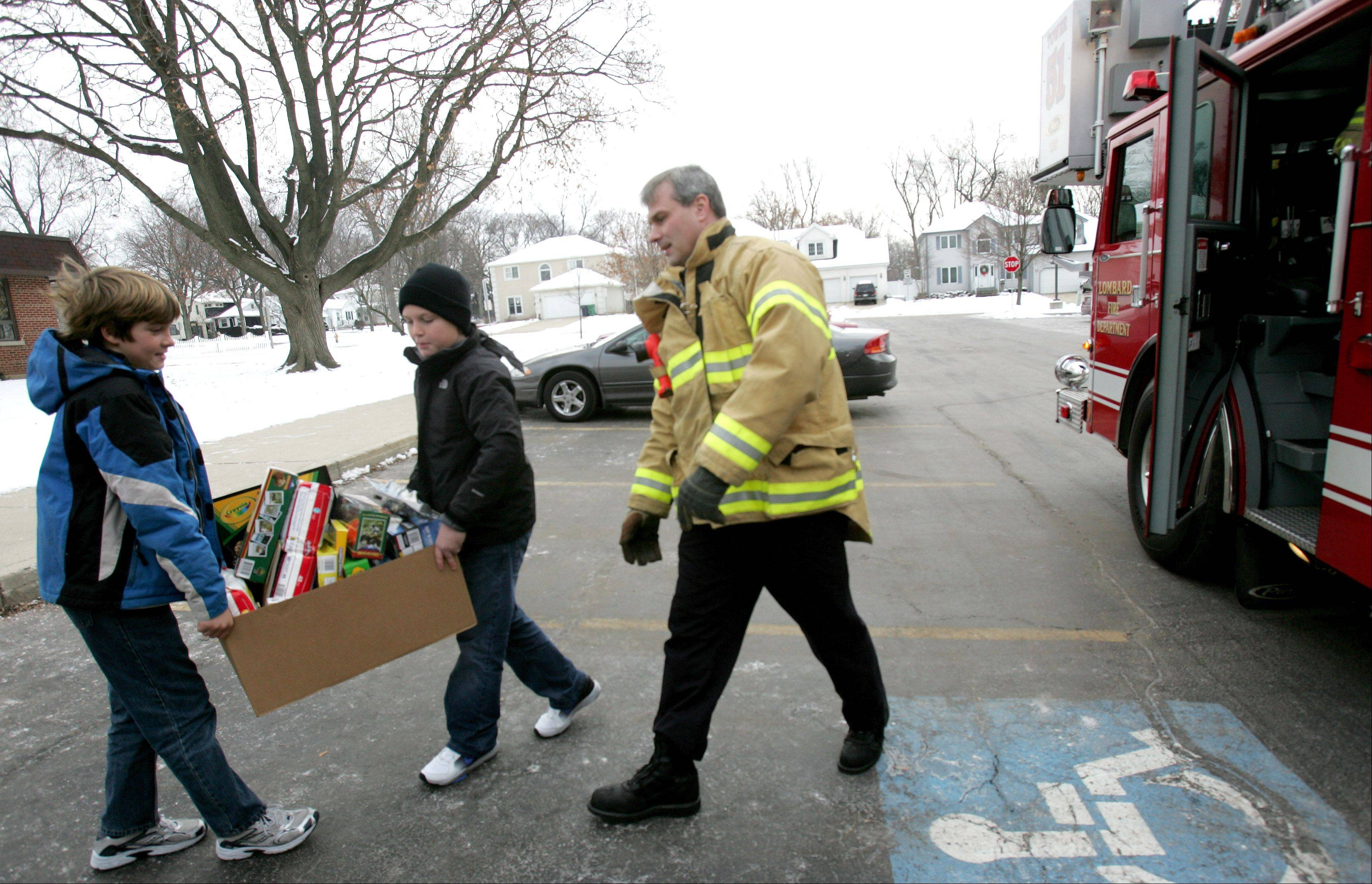Lombard firefighters will launch their 12th annual toy drive shortly after Thanksgiving, culminating with a toy parade Dec. 8.