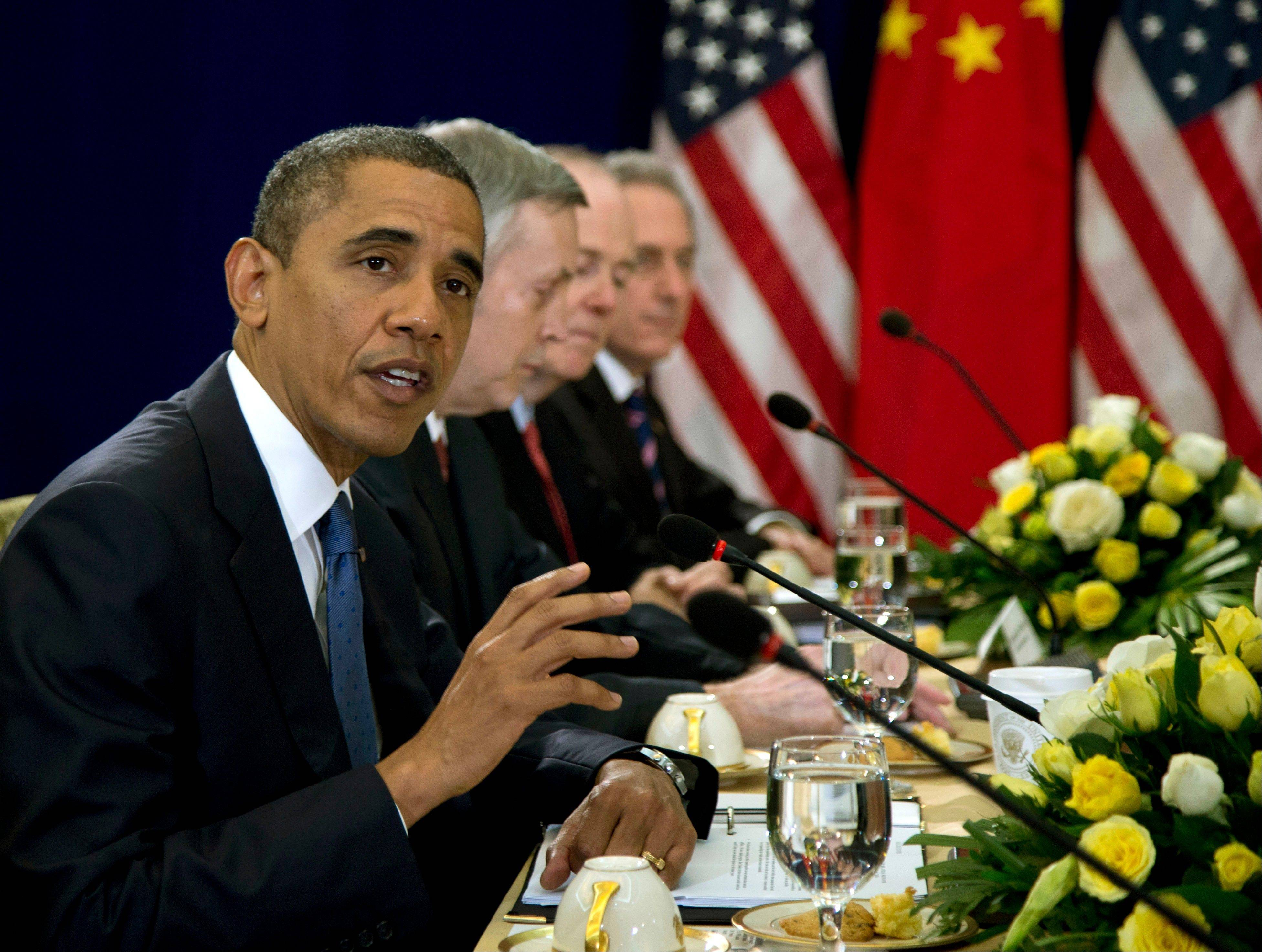 U.S. President Barack Obama gestures as he speaks during a meeting with Chinese Premier Wen Jiabao, unseen, during the East Asia Summit at the Peace Palace in Phnom Penh, Cambodia, Tuesday.
