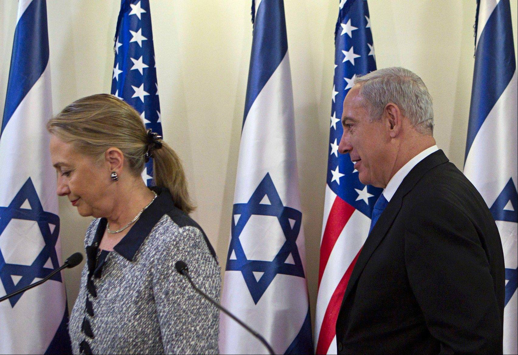 Israel's Prime Minister Benjamin Netanyahu, right, and U.S. Secretary of State Hillary Rodham Clinton leave after delivering joint statements in Jerusalem Tuesday. A diplomatic push to end Israel's nearly weeklong offensive in the Gaza Strip gained momentum Tuesday.