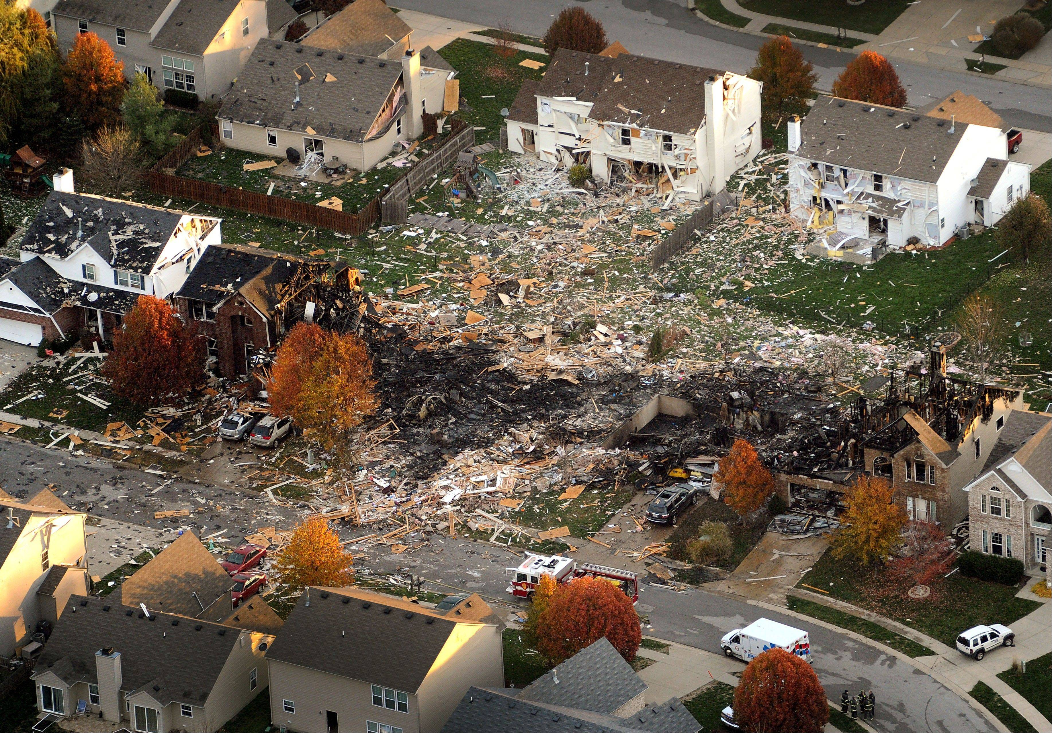 This aerial file photo from Nov. 11, 2012, shows the two homes that were leveled and the numerous neighboring homes that were damaged from a massive explosion that sparked a huge fire and killed two people in Indianapolis.