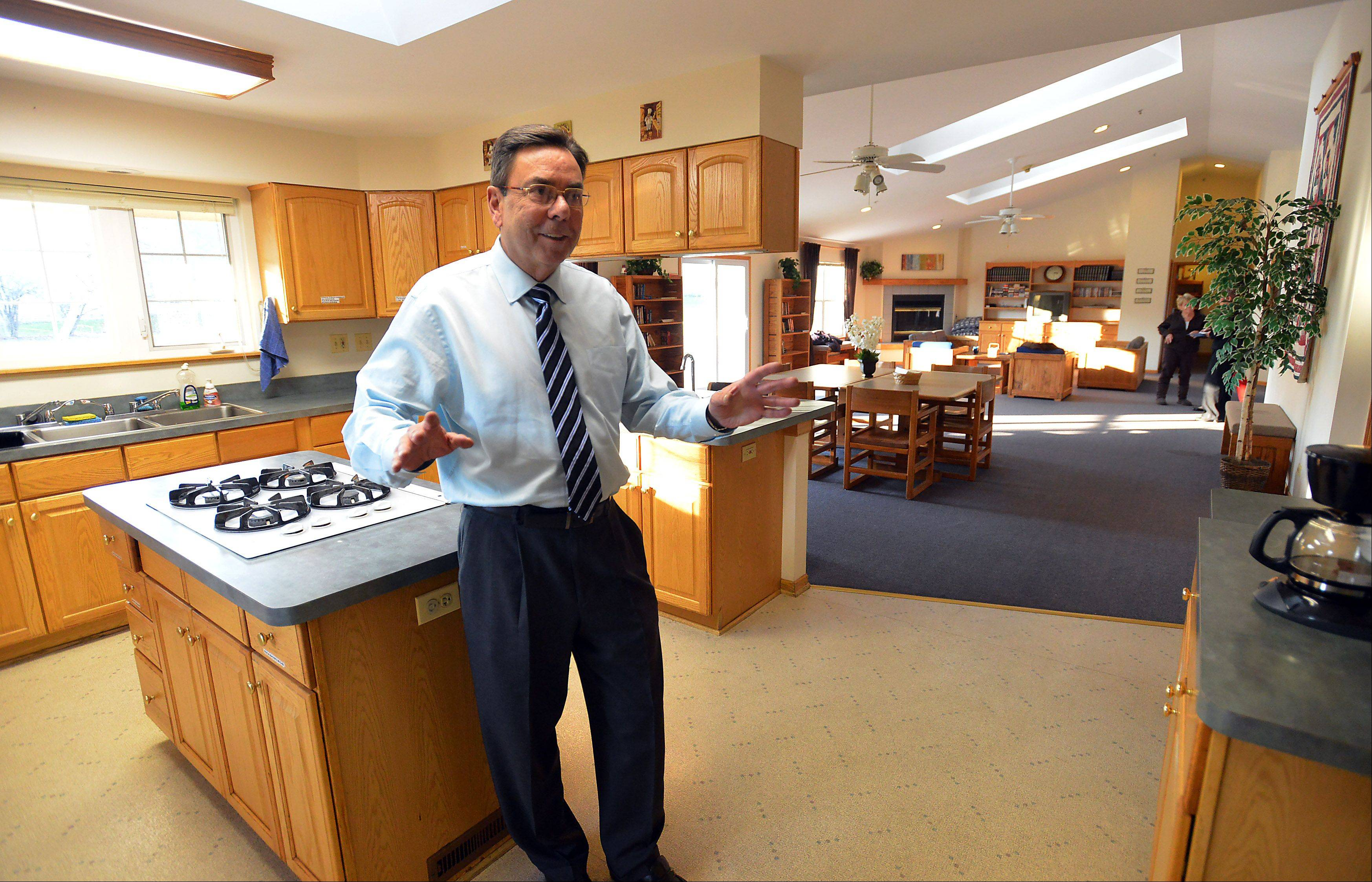 Tom Eagan, associate director of the Shelter, stands in the kitchen of the group home in Palatine that is a home for adolescent boys that face trouble in their homes.