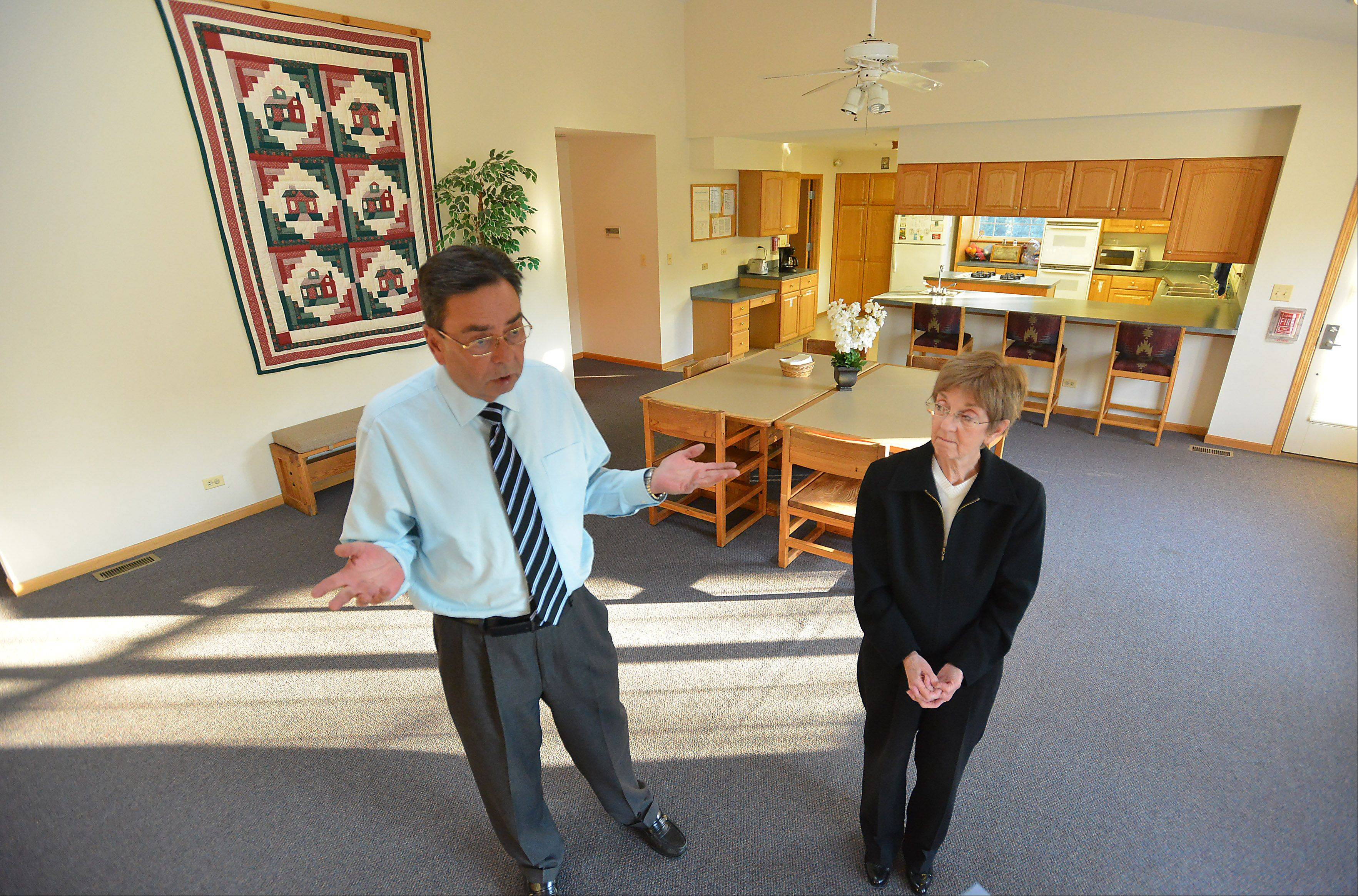 Tom Eagan, associate director of Shelter, and Pat Beck, executive director, stand in the living quarters of the group home in Palatine that is a home for adolescent boys that face trouble in their homes.