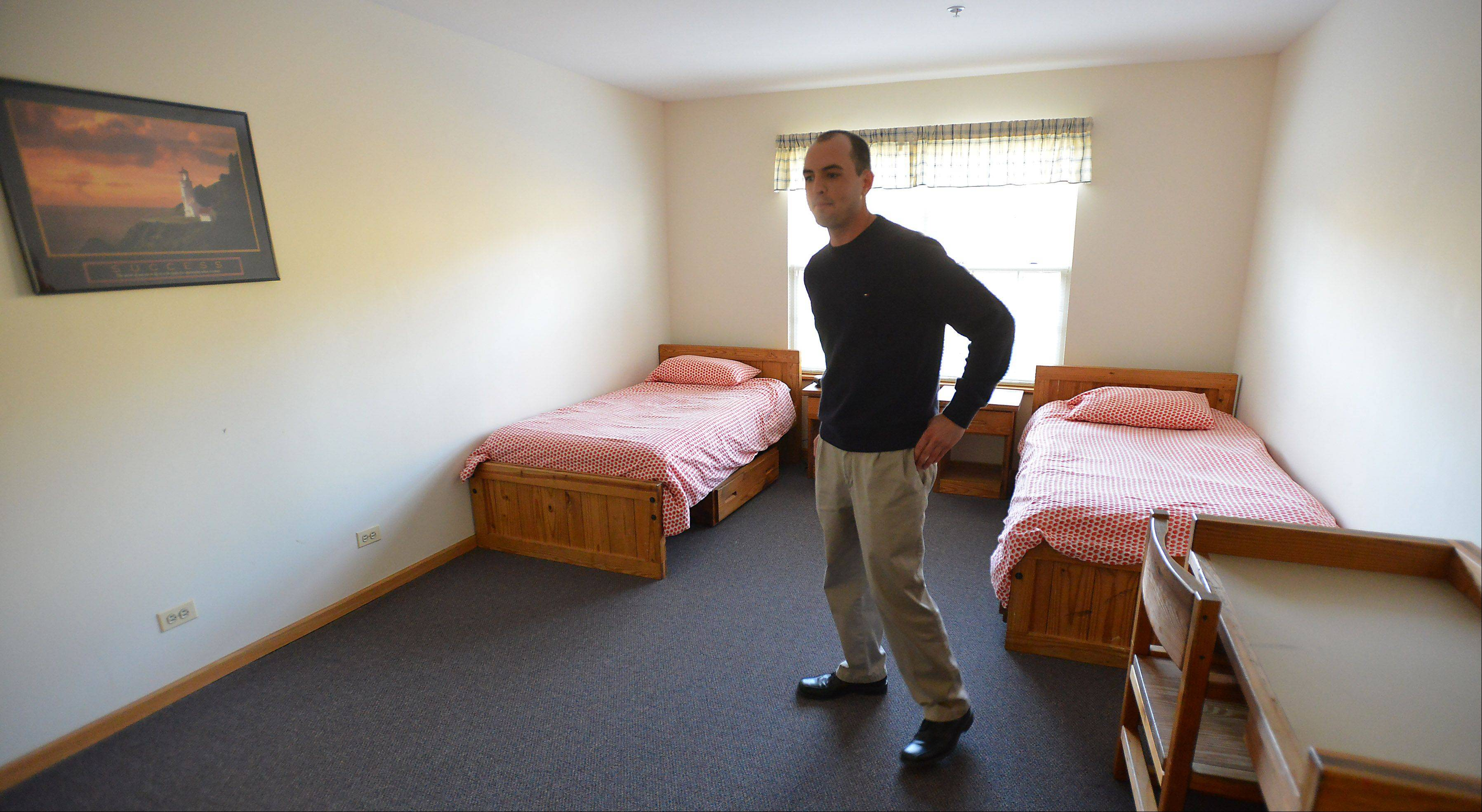 Andy Nogar, group home coordinator of the Shelter home in Palatine, shows off the bedroom where the adolescent boys sleep when they come to stay when trouble at home is too much for them.