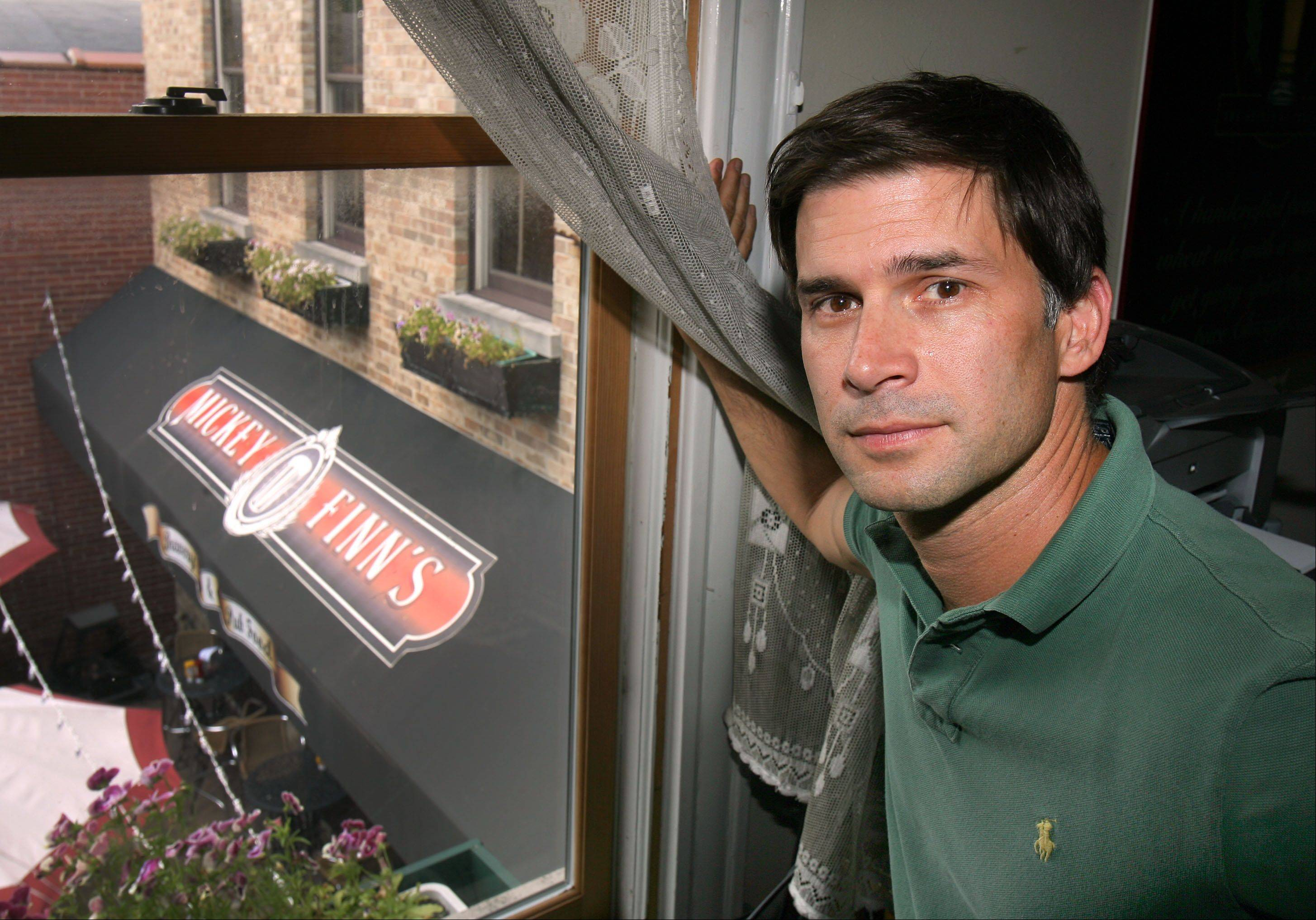 Brian Grano, proprietor of Mickey Finn's brewery in Libertyville, stands in his office, which overlooks the beer garden. The brew pub plans to move from its historic location at 412 N. Milwaukee Ave. to a new, larger building about a block away in time for Thanksgiving Eve 2013.