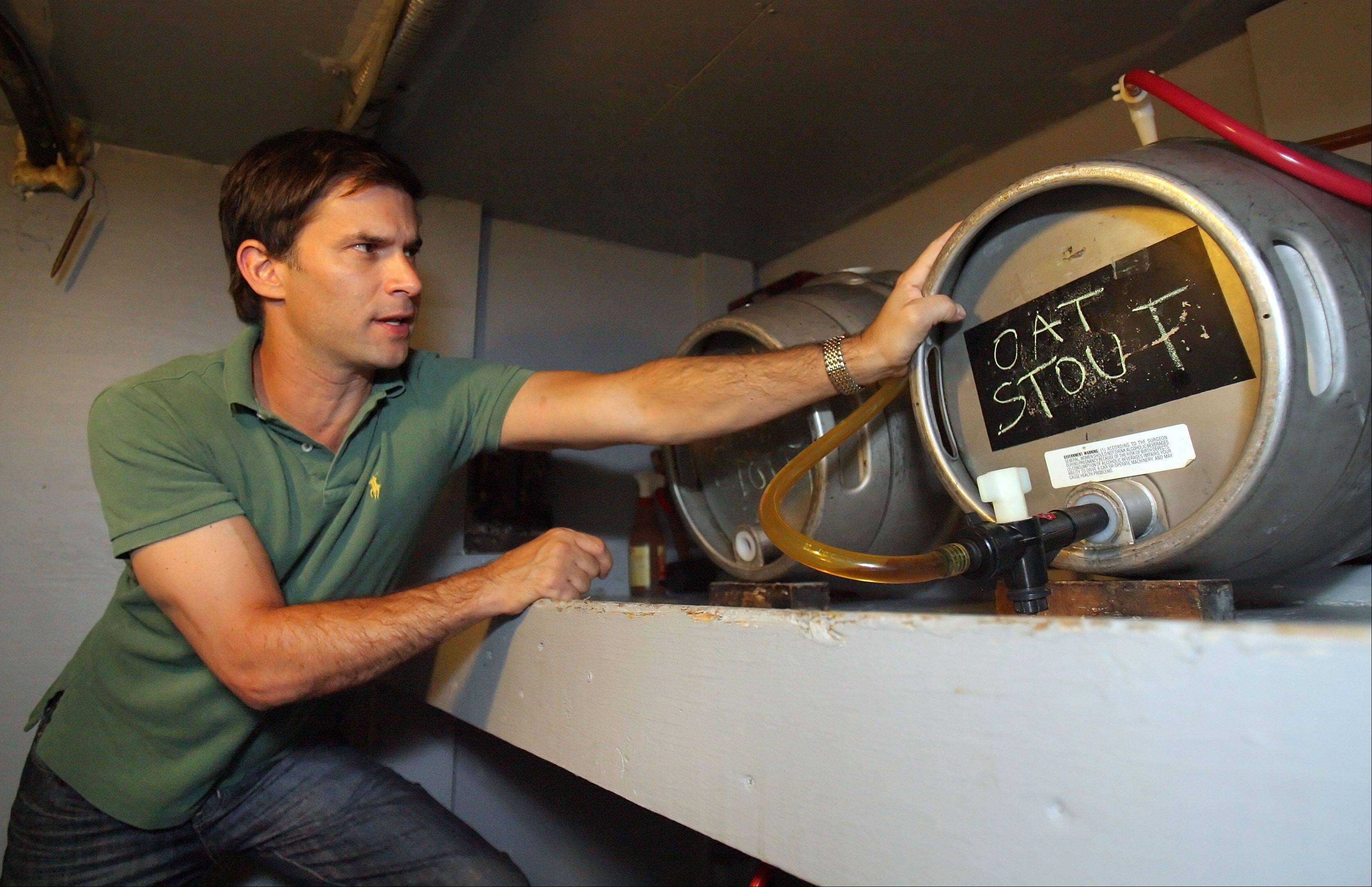 Owner Brian Grano shows the old keg room in the basement at Mickey Finn's, a landmark brew pub in Libertyville.
