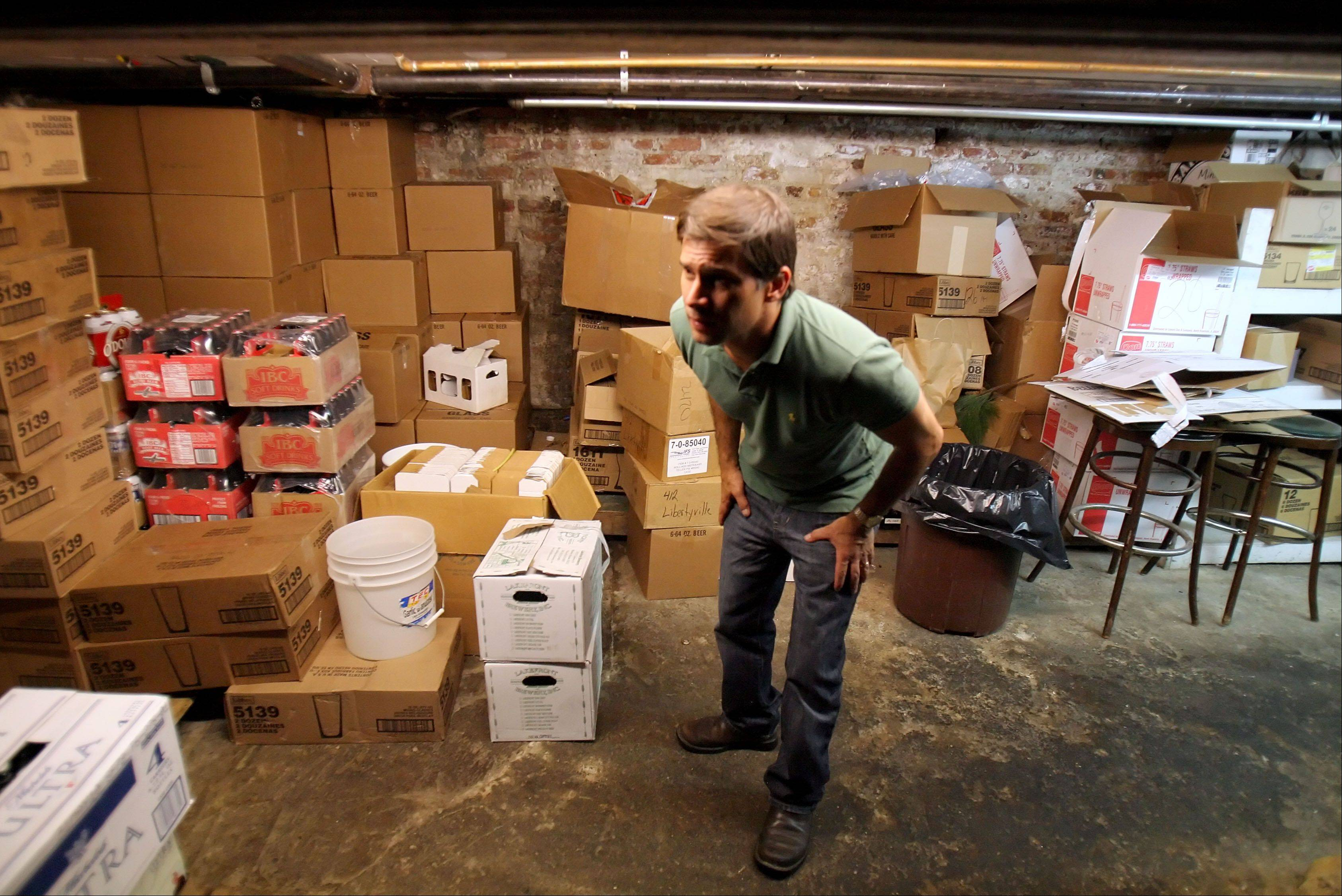Brian Grano, proprietor of Mickey Finn's ducks as he traverses the basement that has remained virtually unchanged for 100 years. The Libertyville brew pub plans to move into a new, larger facility a block away by next fall.