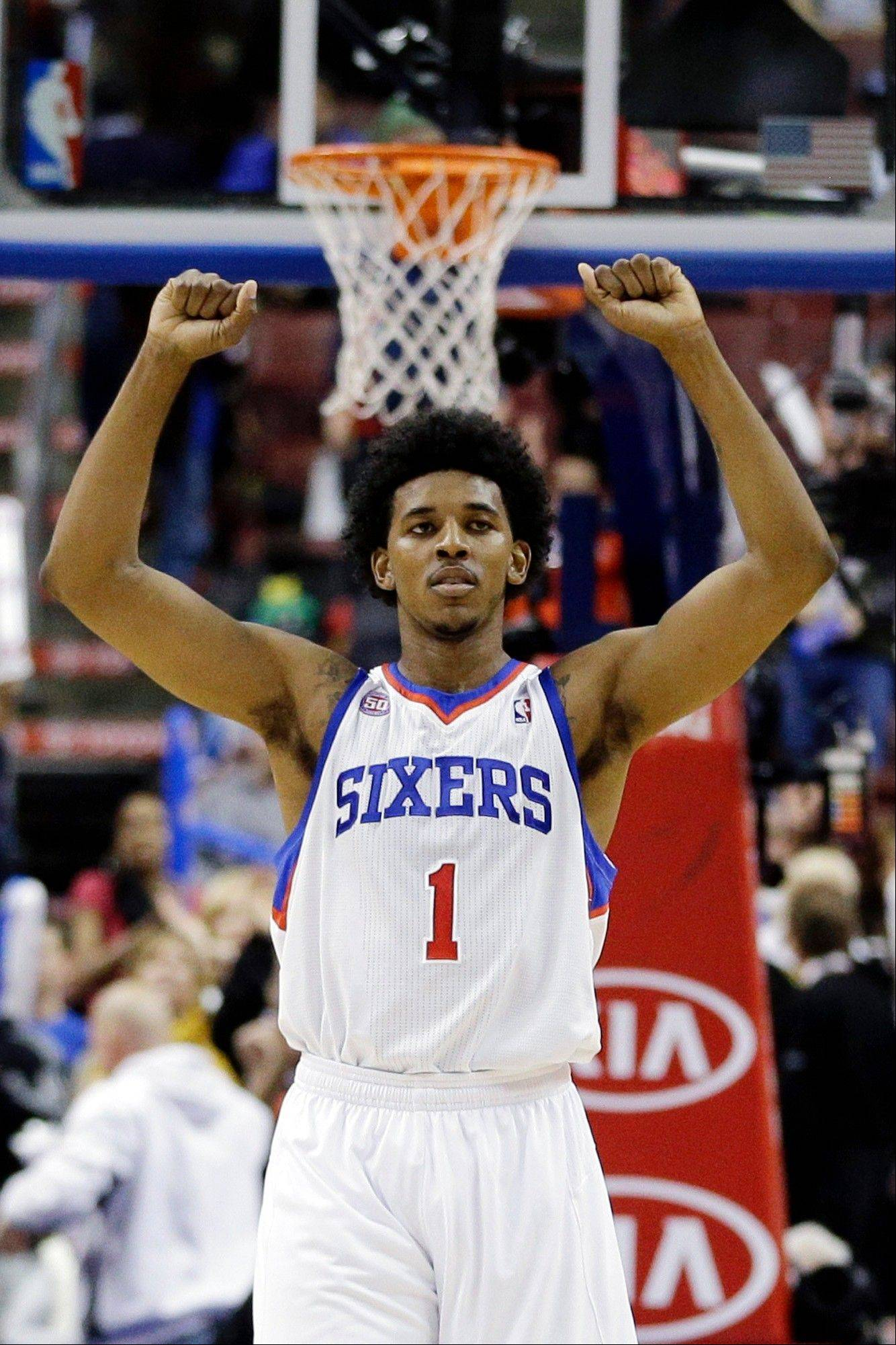 The Philadelphia 76ers' Nick Young reacts to a score Tuesday during the second half against the Toronto Raptors in Philadelphia. Philadelphia won 106-98.
