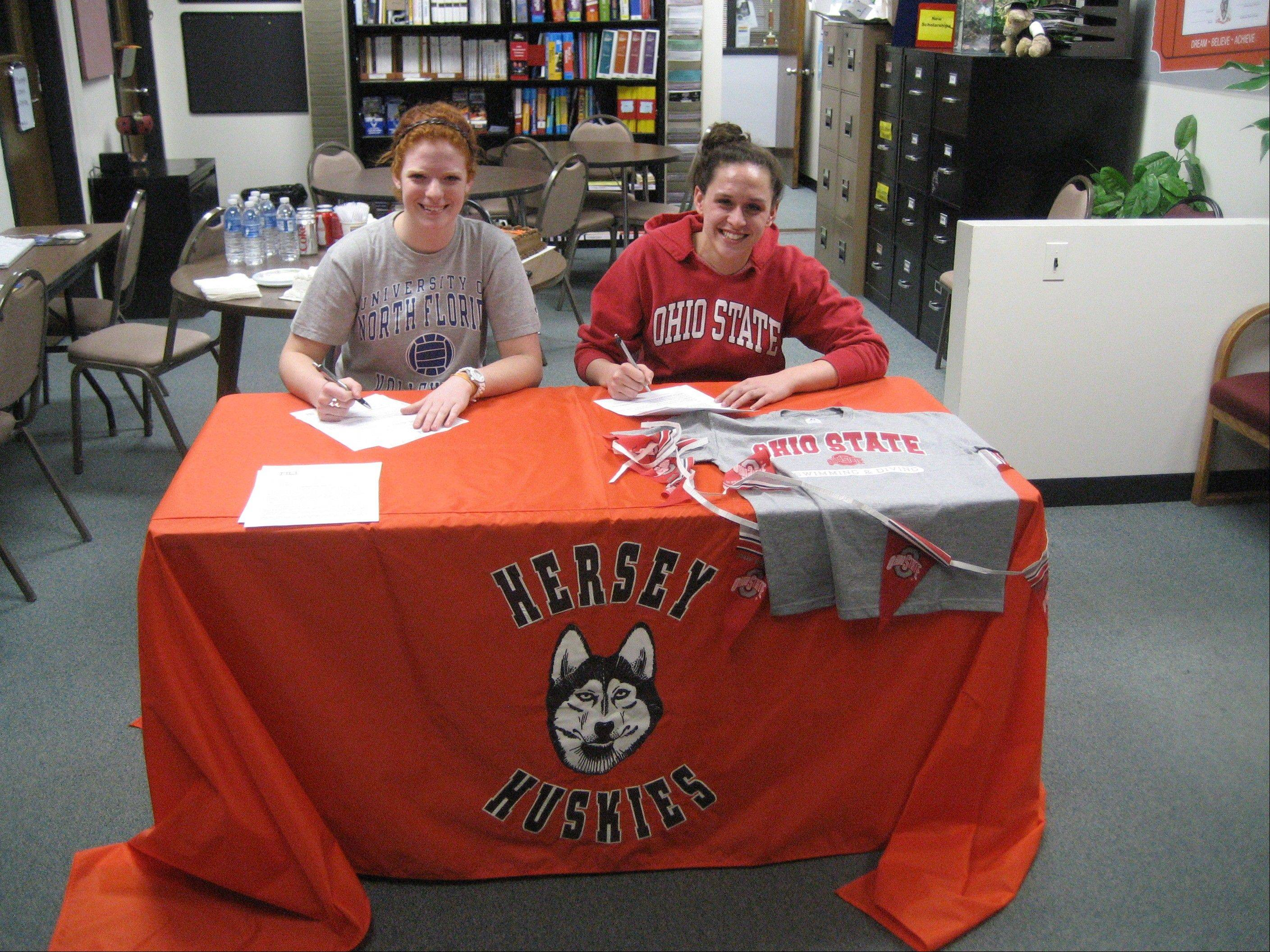 Hersey volleyball standout Abby Fesl, left, signs her letter of intent with Northern Florida, and all-state swimmer Amanda Petro signs her letter to compete for Ohio State.