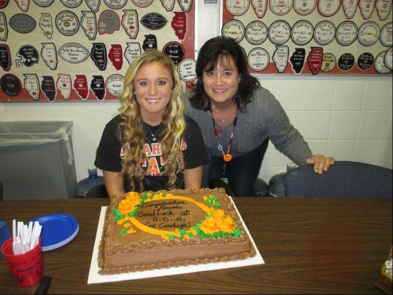 Miranda Cavin signs her letter of intent with Oklahoma State.