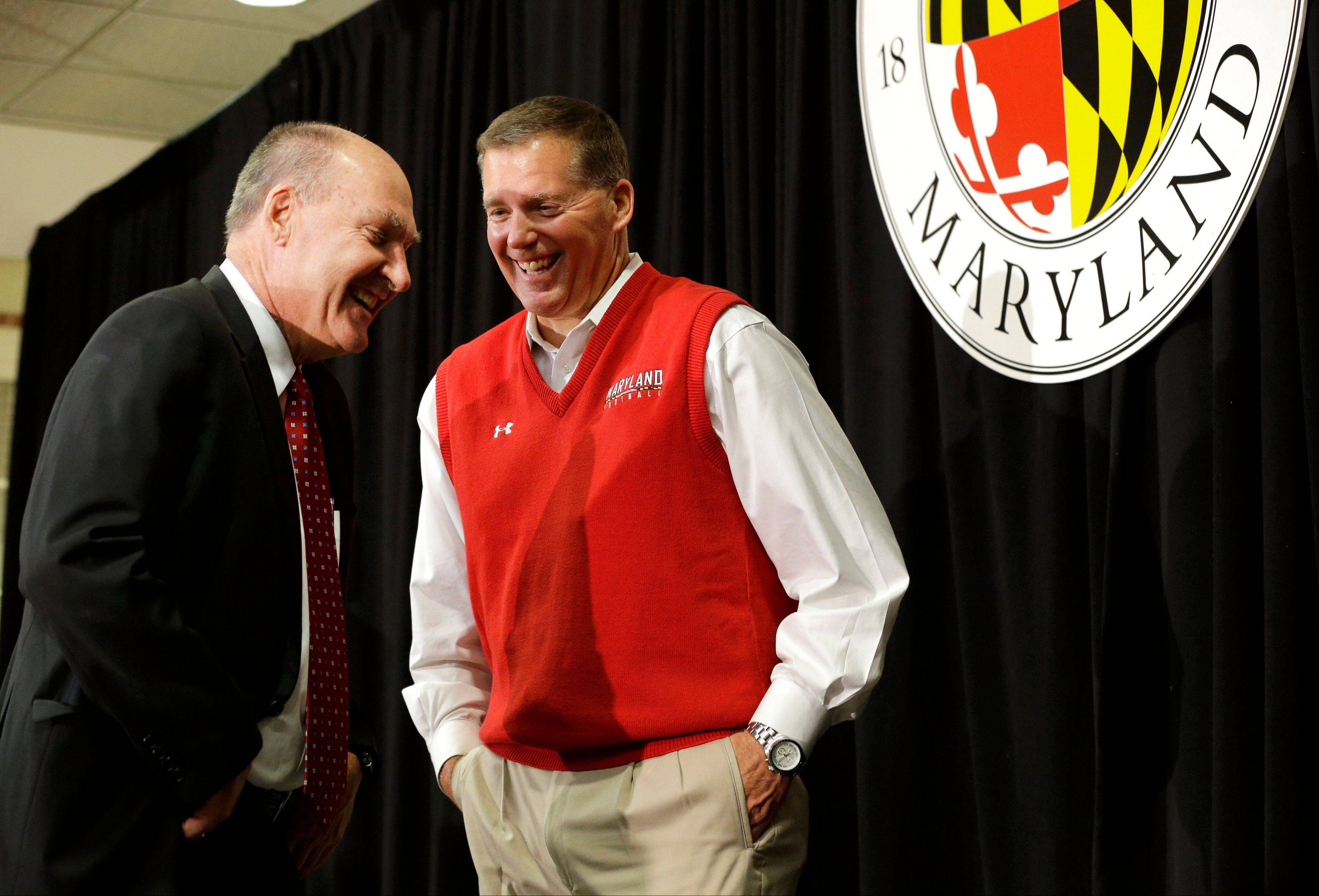 Big Ten Commissioner Jim Delany, left, speaks Monday with Maryland football coach Randy Edsall after a news conference that was held to announce Maryland's decision to move to the Big Ten. Edsall, 6-17 in his two seasons at the school, is certain Maryland will flourish in its new conference.