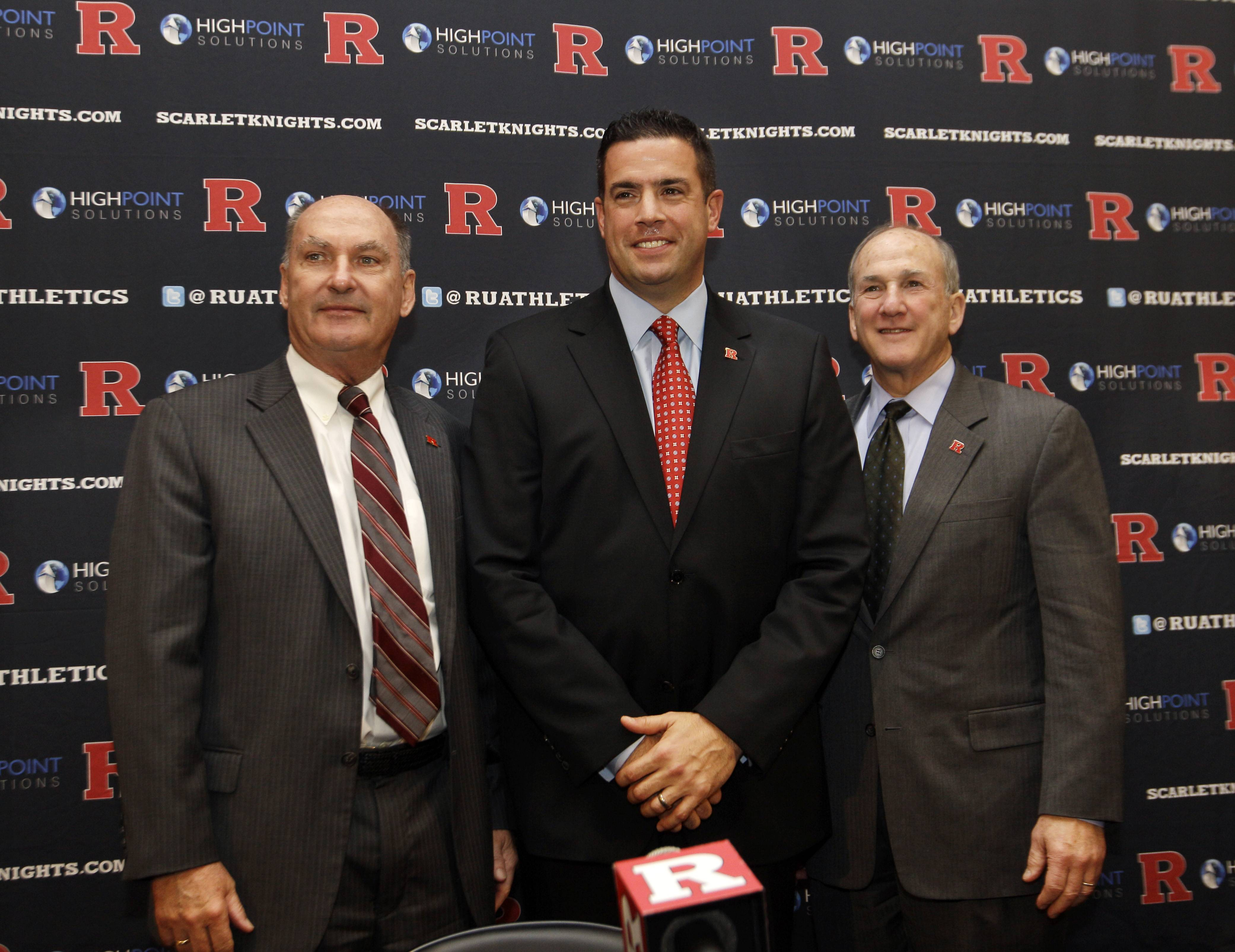 Rutgers Director of Intercollegiate Athletics Tim Pernetti, center, stands with Rutgers President Robert Barchi, right, and Big Ten Conference Commissioner Jim Delany during a news conference Tuesday in Piscataway, N.J., after they announced that Rutgers will join the Big Ten. Rutgers will join the conference in all sports at a date to be determined.