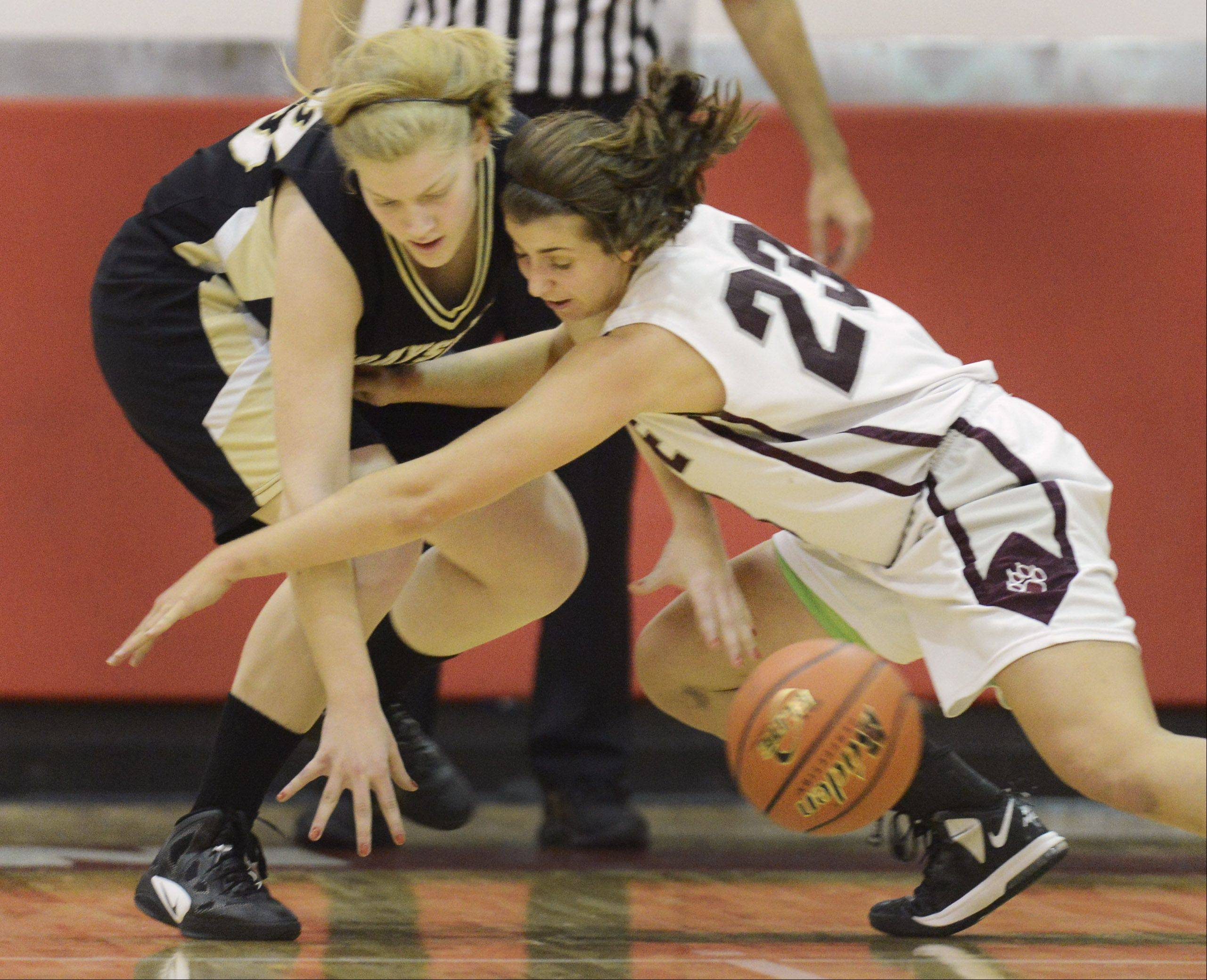 Grayslake North's Joanna Guhl, left, and Prarie Ridge's Alex Neckopolous try to control a loose ball during Friday's game at Mundelein.