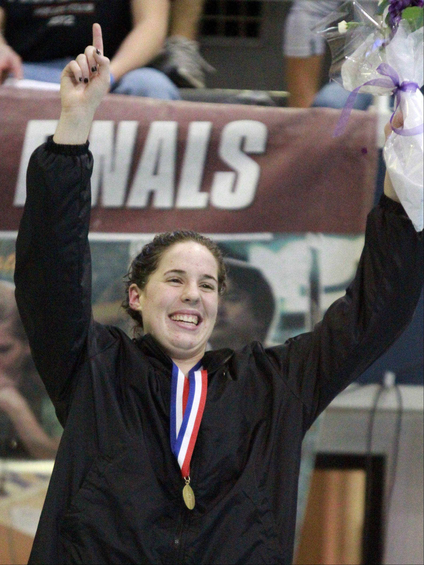 Downers Grove�s Gabby Sims reacts to placing first in the 100-yard freestyle at the IHSA state championships in Evanston on Saturday.