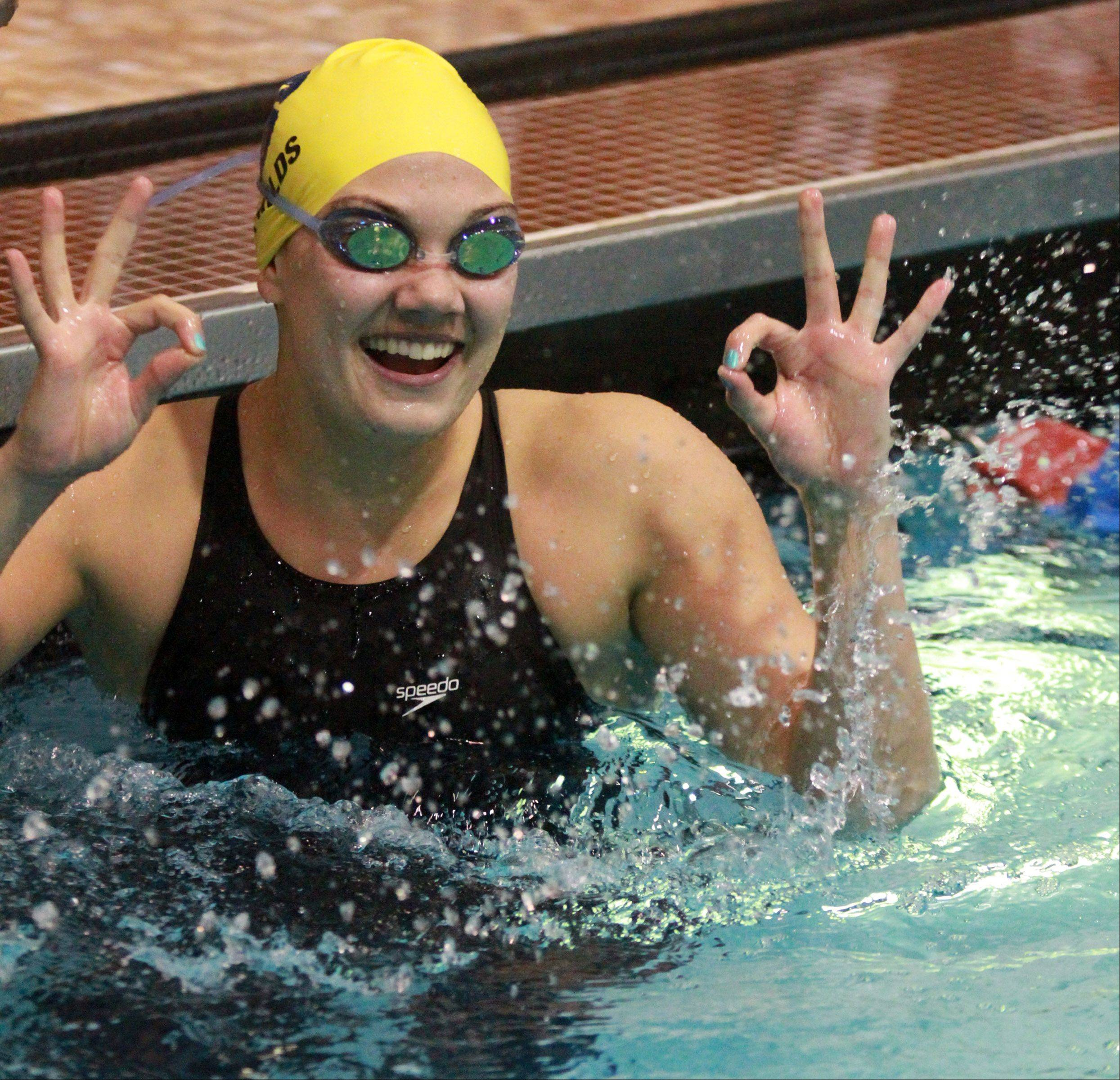 Neuqua Valley�s Megan Childs turns towards fans and reacts to her team placing third in the 200-yard freestyle relay Saturday.