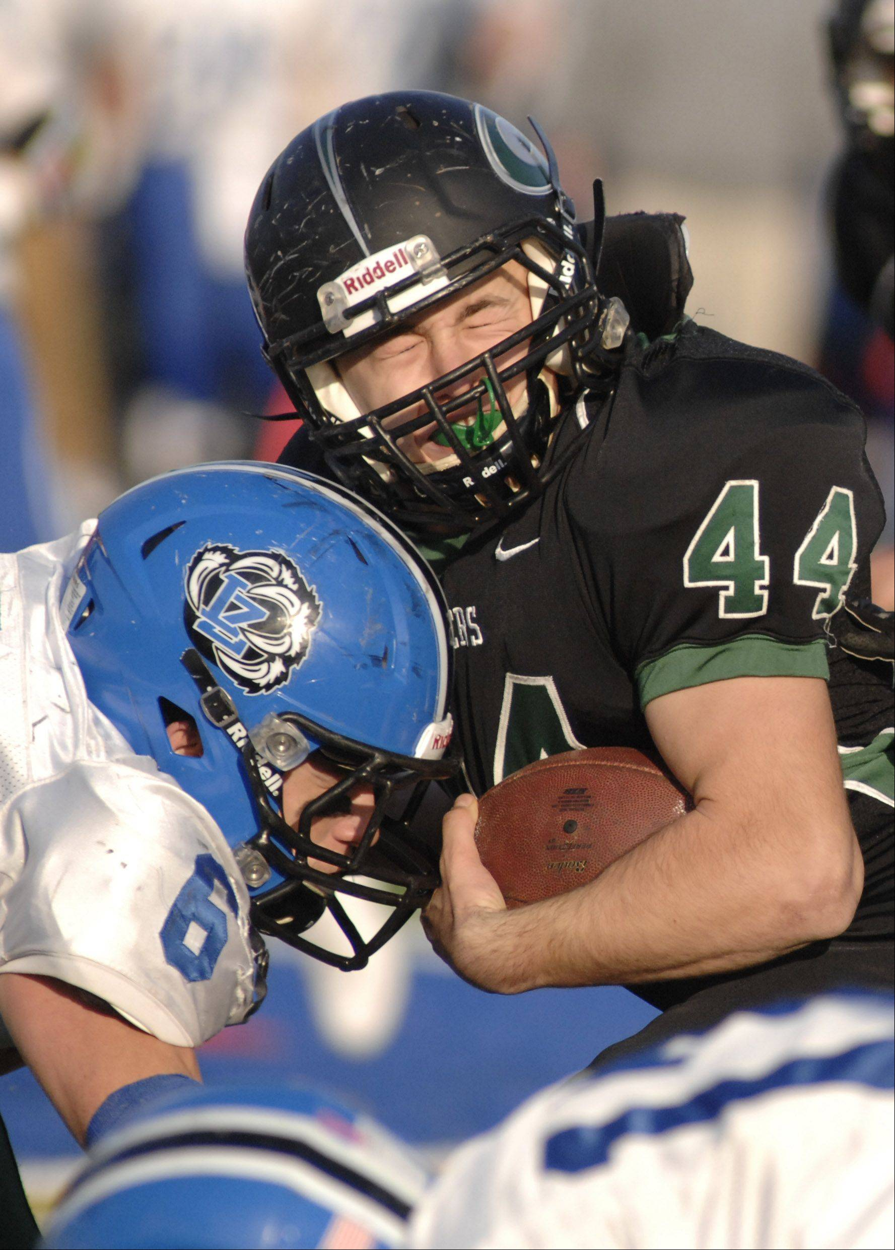 Lake Zurich's Sean Lynch stops Glenbard West's AJ Della Polla during Saturday's semifinal football game.
