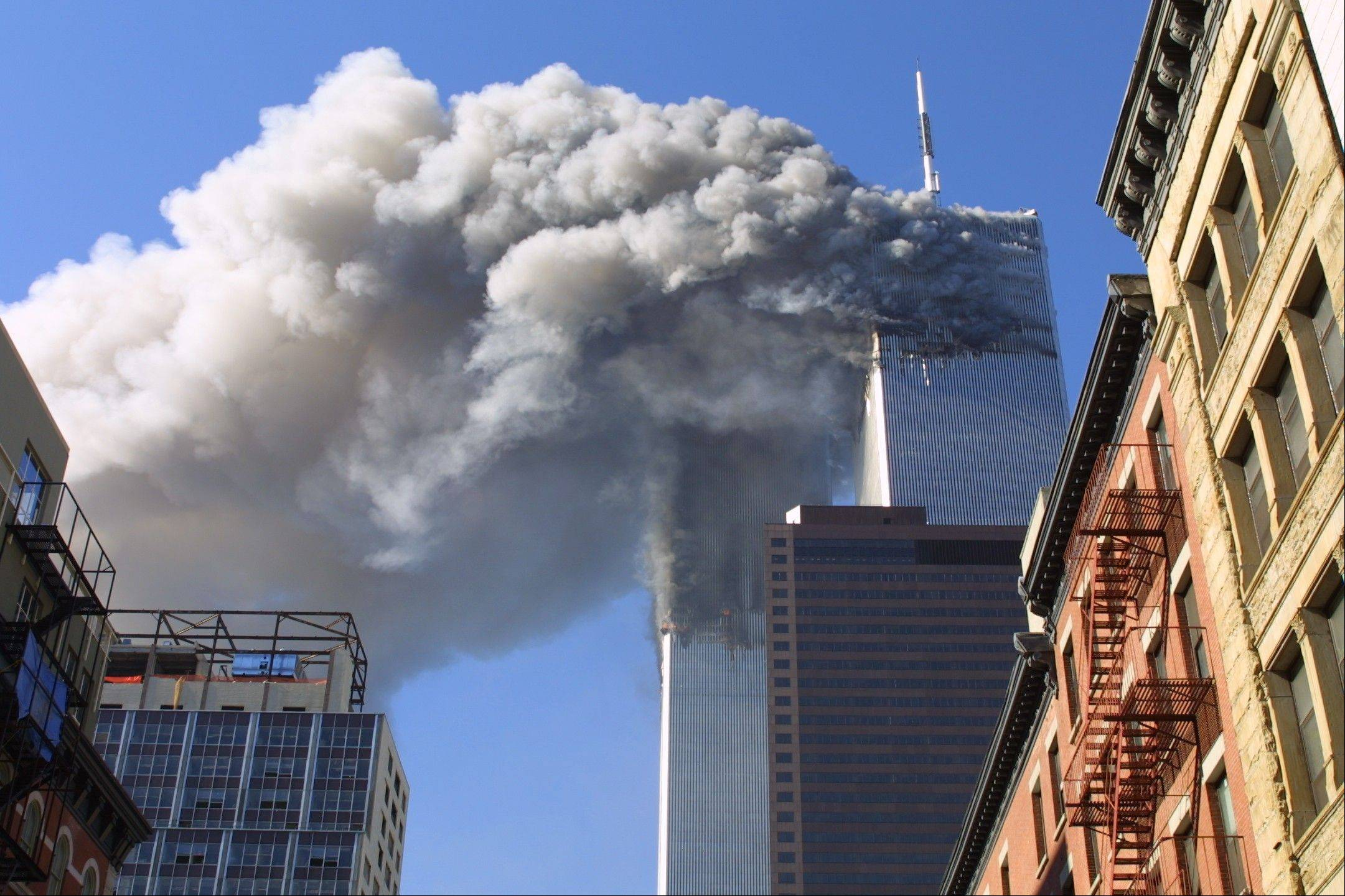 In this Sept. 11, 2001, file photo, the twin towers of the World Trade Center burn after hijacked planes crashed into them in New York.