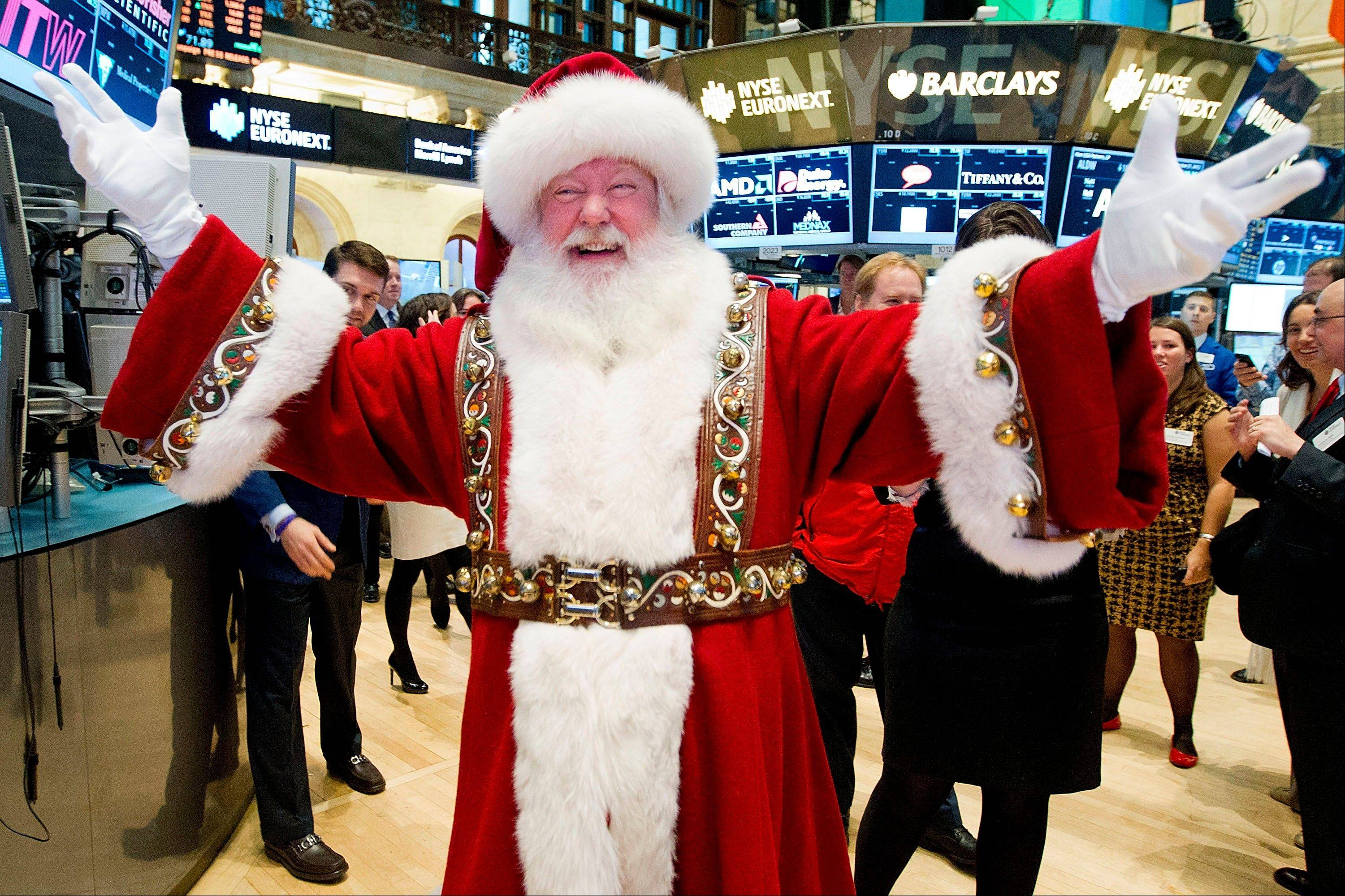 A man portraying Santa Claus visits the trading floor of the New York Stock Exchange before he participated in opening bell ceremonies featuring the Macy�s Thanksgiving Day Parade.