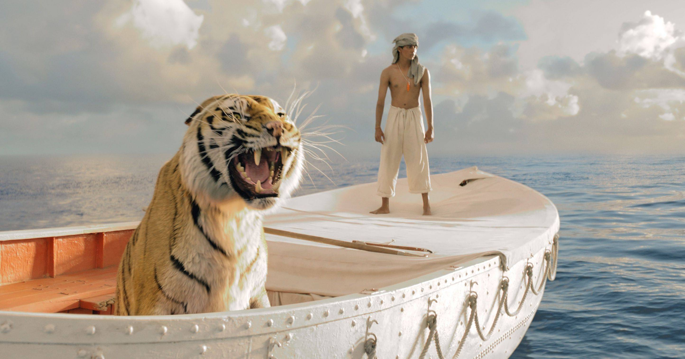 "Pi (Suraj Sharma) makes peace with a Bengal tiger on a life boat in Ang Lee's amazing adventure ""Life of Pi."""