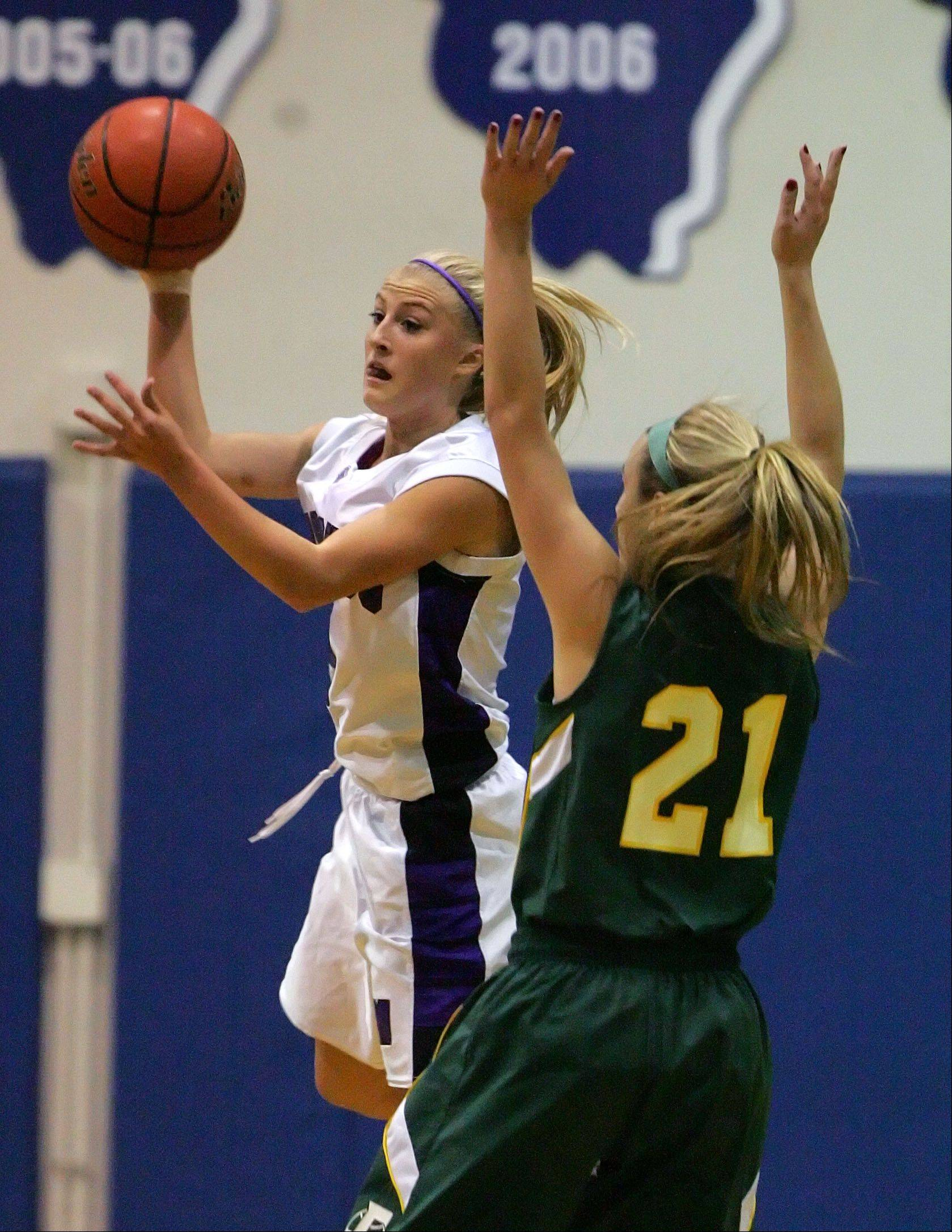 Steve Lundy/slundy@dailyherald.com Rolling Meadows' Jackie Kemph, left, drives on Fremd's Ashley McConnell during their game Wednesday night at Lake Zurich High School.
