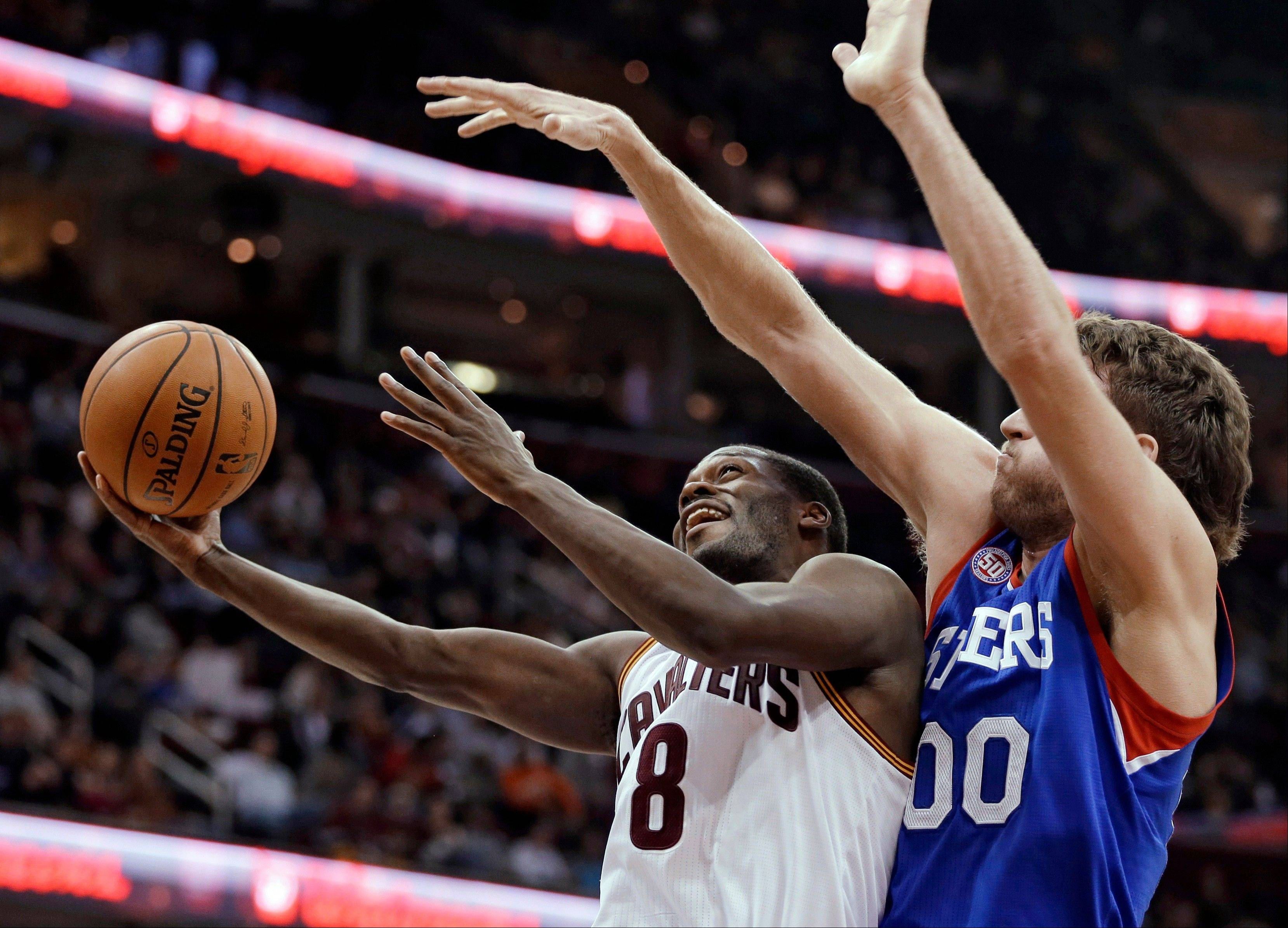 The Cavaliers� Jeremy Pargo shoots against Philadelphia�s Spencer Hawes in the fourth quarter Wednesday in Cleveland.