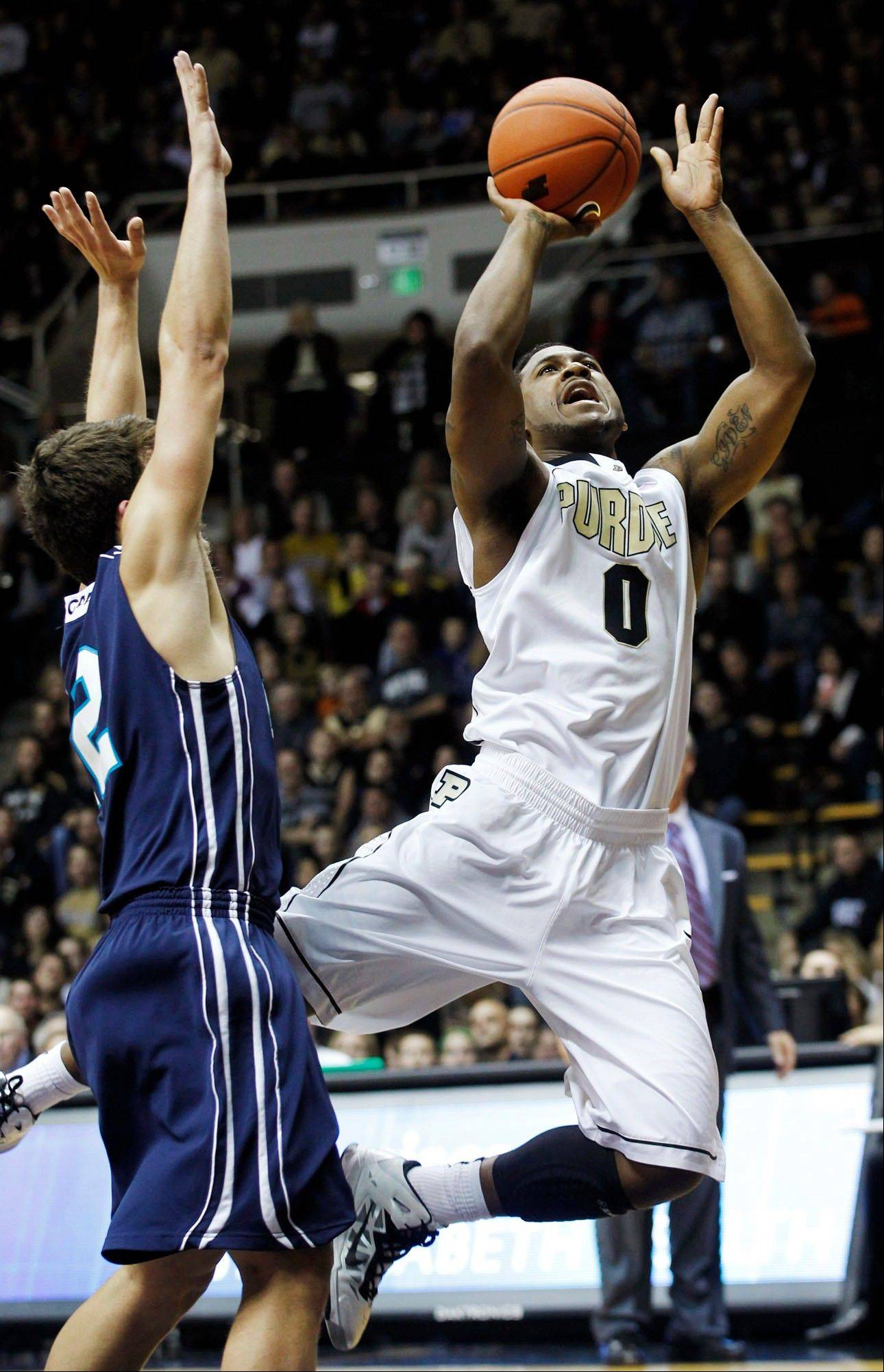 Purdue�s Terone Johnson shoots while being fouled by North Carolina-Wilmington�s Tanner Milson during the first half of their game Wednesday in West Lafayette, Ind.