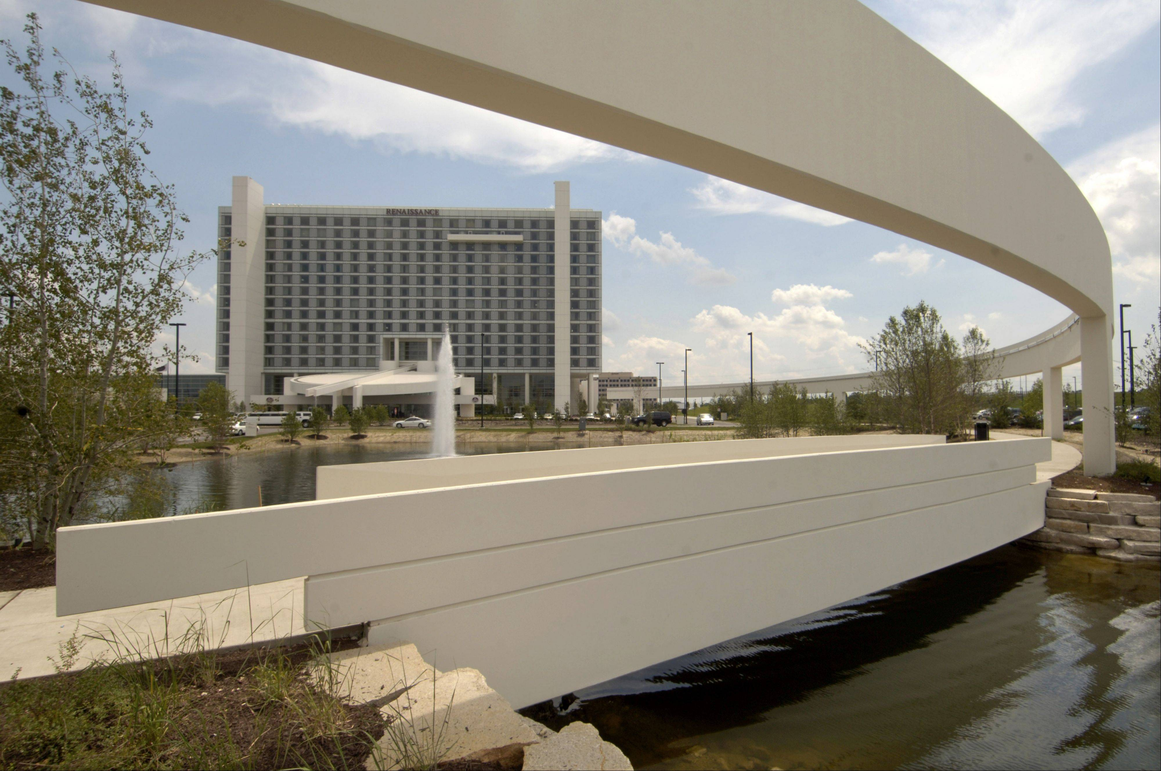 "Schaumburg officials foresee continued improvement in business at the 6-year-old Renaissance Hotel and Schaumburg Convention Center in 2013, so long as the looming ""fiscal cliff"" is avoided."