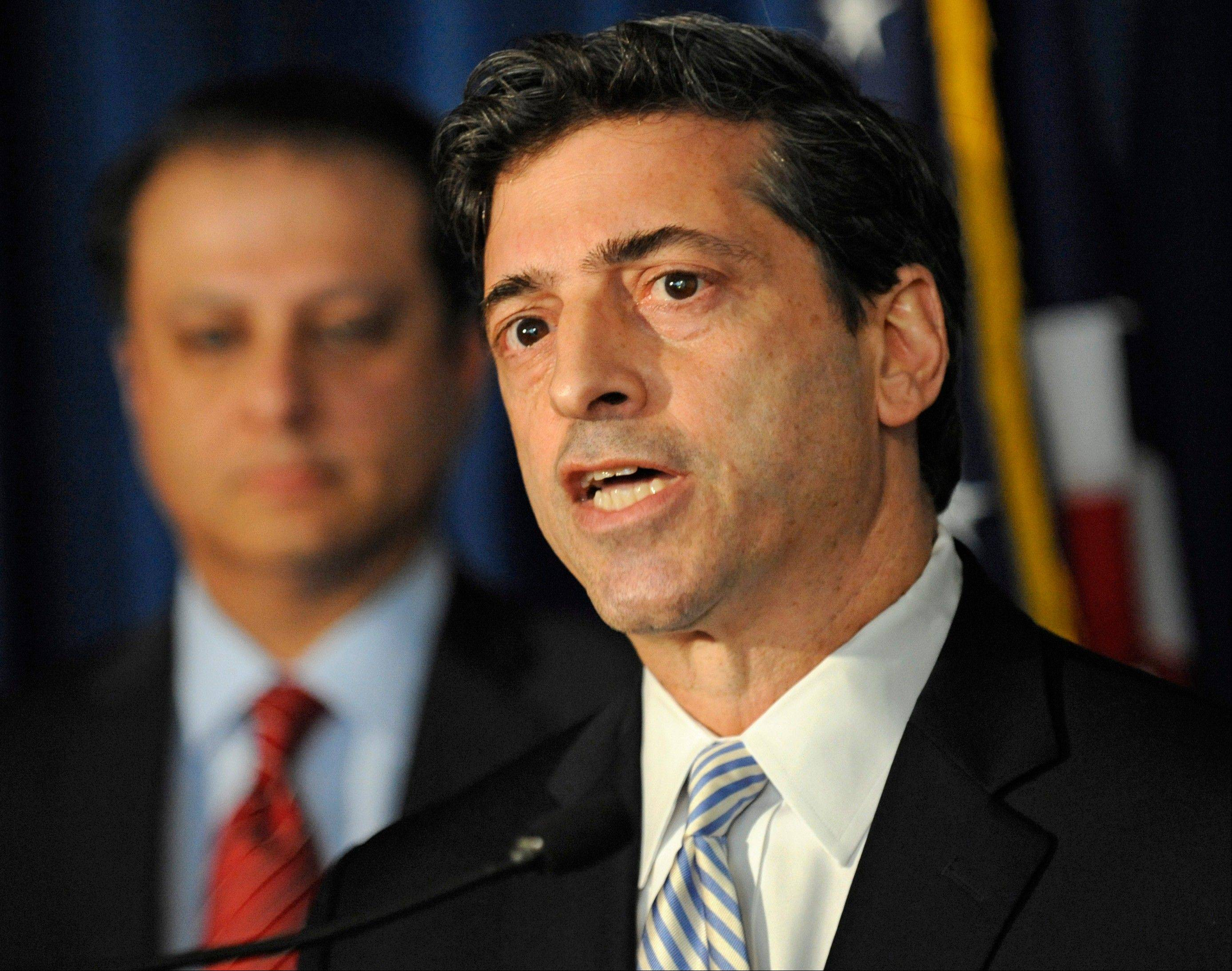 U. S. Attorney for the Southern district of N.Y. Preet Bharara, left, looks on as Robert Khuzami, director of the SEC division of enforcement speaks at a news conference, Tuesday Mathew Martoma, a former hedge fund portfolio manager was arrested Tuesday on charges that he helped carry out the most lucrative insider trading scheme in U.S. history, nabling investment advisers and their hedge funds to make more than $276 million in illegal profits.