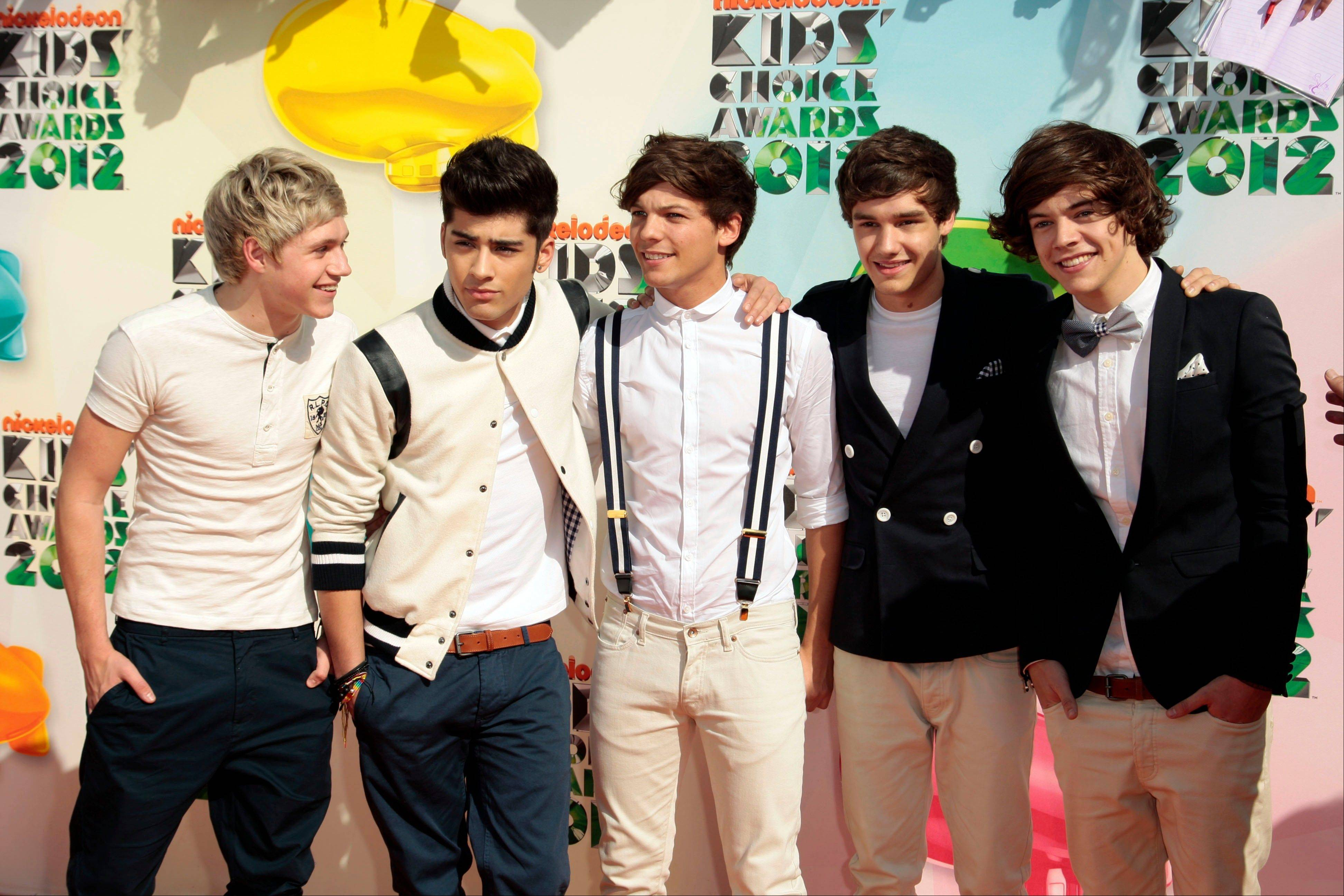 "One Direction, from left, Niall Horan, Zayn Malik, Louis Tomlinson, Liam Payne and Harry Styles are enjoying a popularity surge with the release of their sophomore album, ""Take Me Home,"" which sold 540,000 copies in its first week."