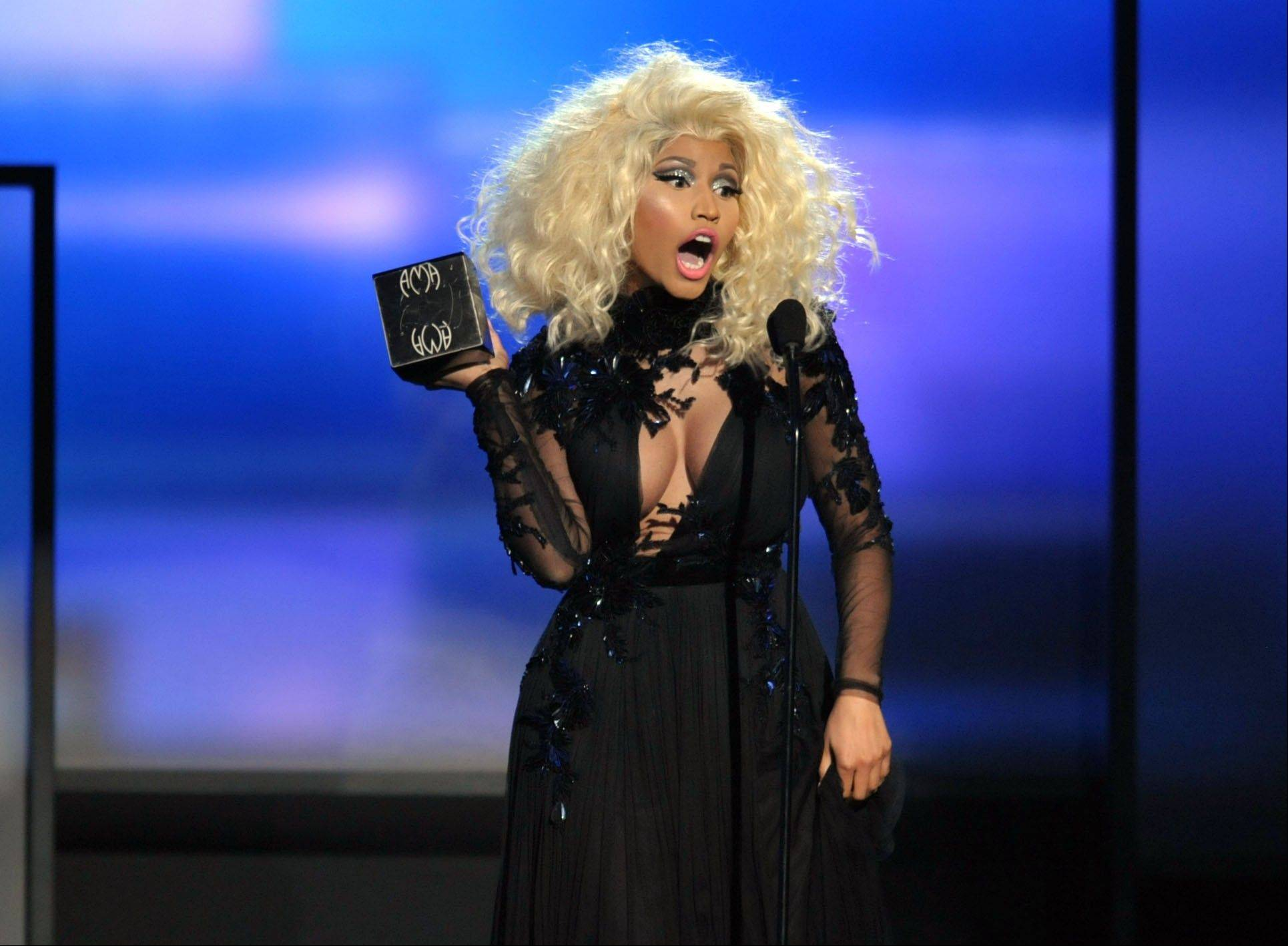 Nicki Minaj accepts the award for favorite artist -- rap/hip-hop at the 40th Anniversary American Music Awards on Sunday.
