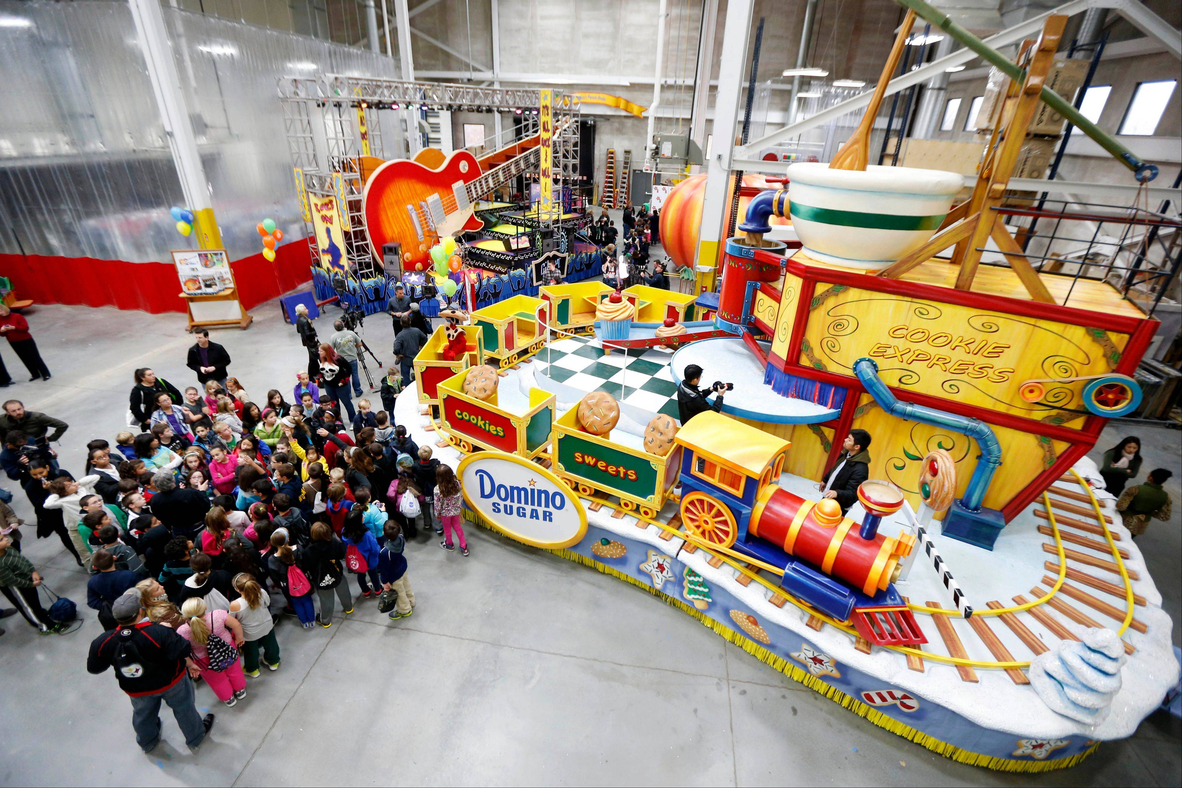 Schoolchildren are given a sneak peek of the new floats for the Macy's Thanksgiving Day Parade during a field trip to the Macy's Studio.